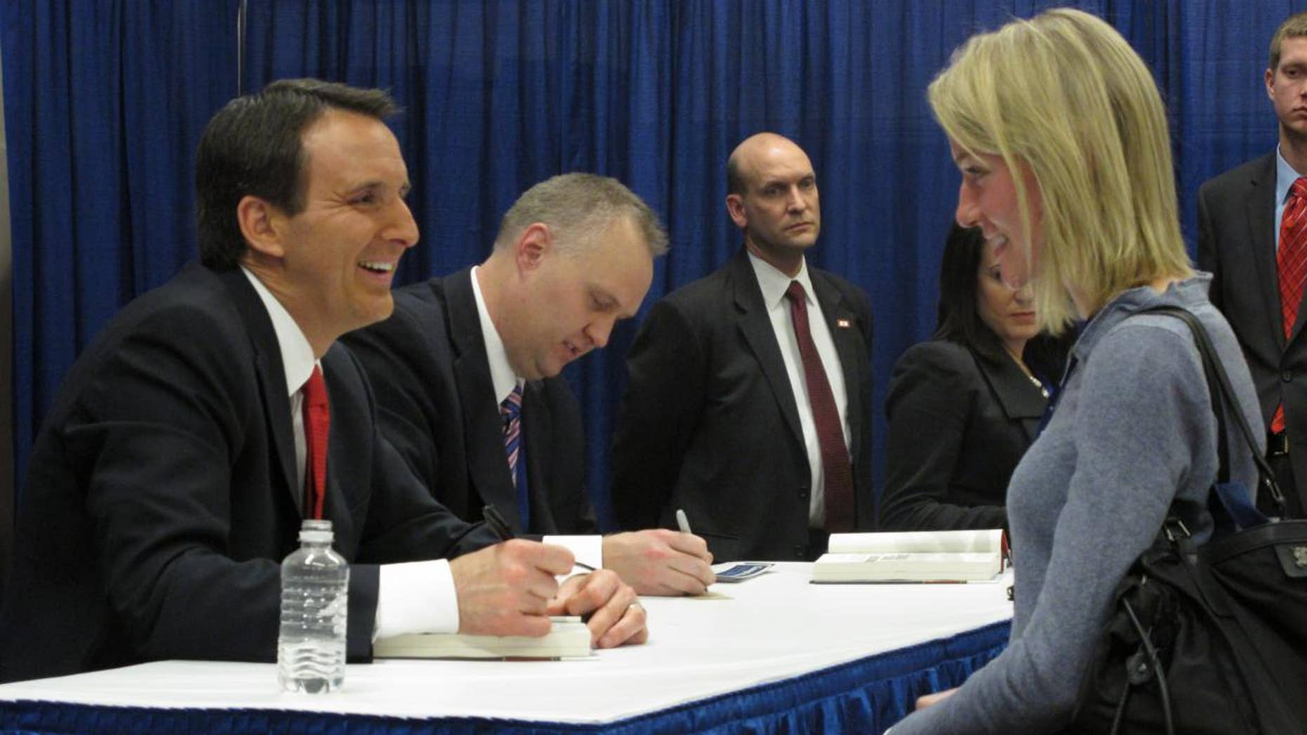 Former Minnesota Gov. Tim Pawlenty (R) signs books at the Conservative Political Action Conference Febuary 11. (Fox News Photo)