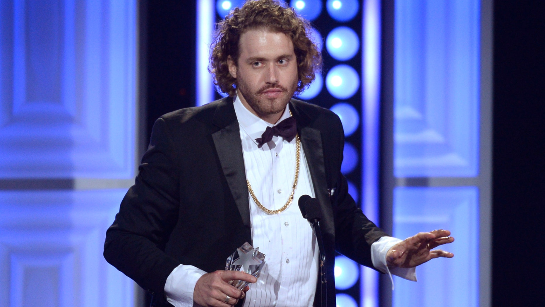 "T.J. Miller accepts the ""Best Supporting Actor - Comedy"" award for his role on the HBO series ""Silicon Valley"" at the 5th Annnual Critics' ChoiceTelevision Awards in Beverly Hills, California May 31, 2015.  REUTERS/Kevork Djansezian - TB3EB6101JBC9"