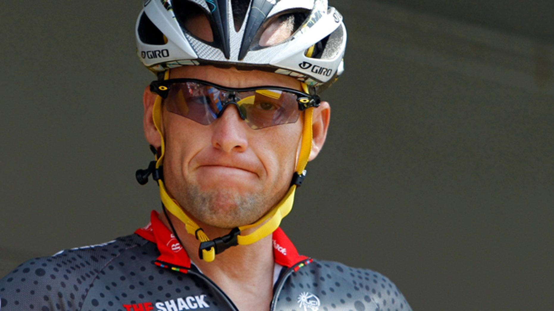 July 6, 2010: Lance Armstrong grimaces prior to the start of the third stage of the Tour de France cycling race in Wanze, Belgium.