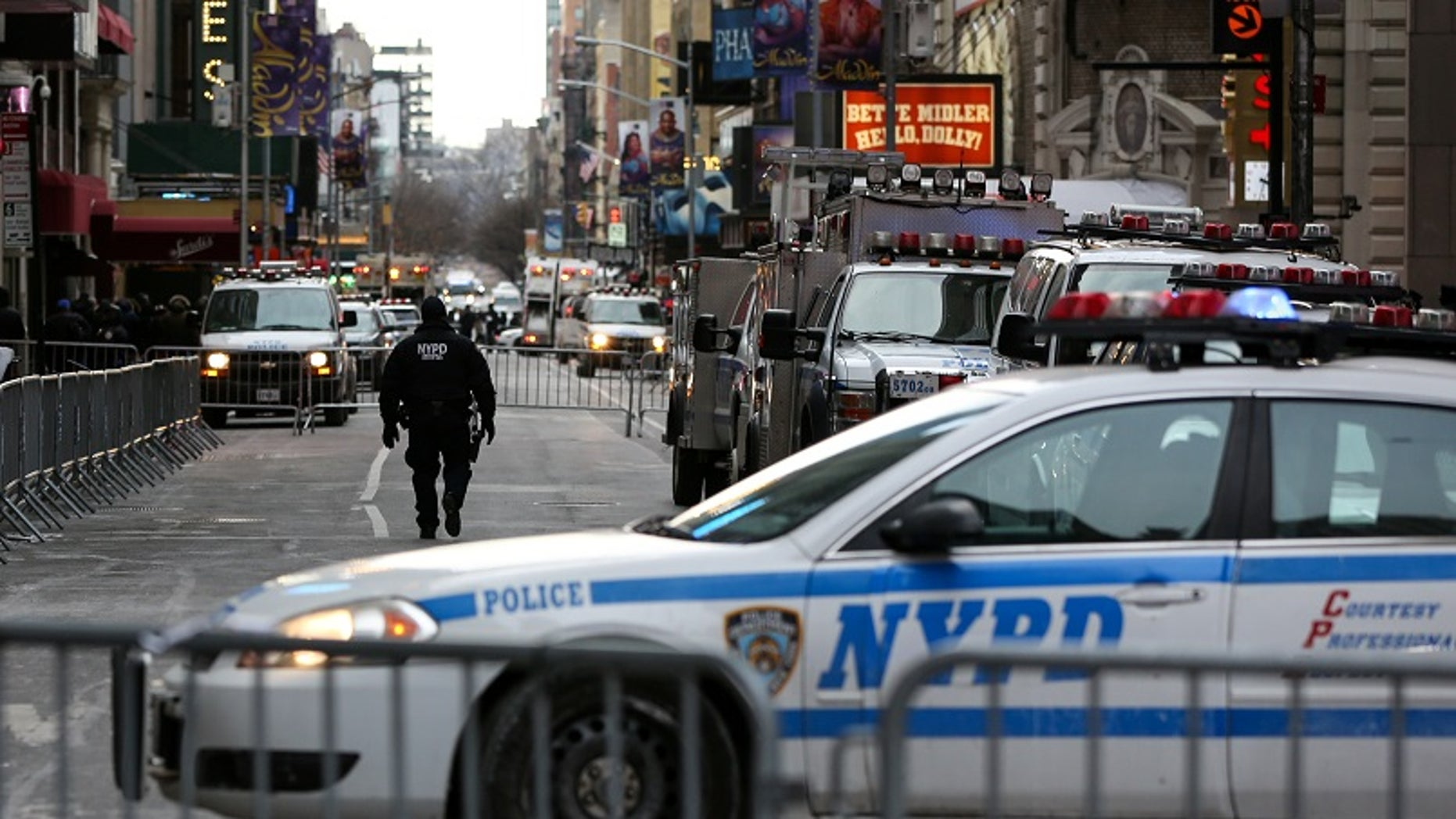 New York Police Department (NYPD) officers secure Times Square ahead of New Year's Eve celebrations, Dec. 31, 2017.