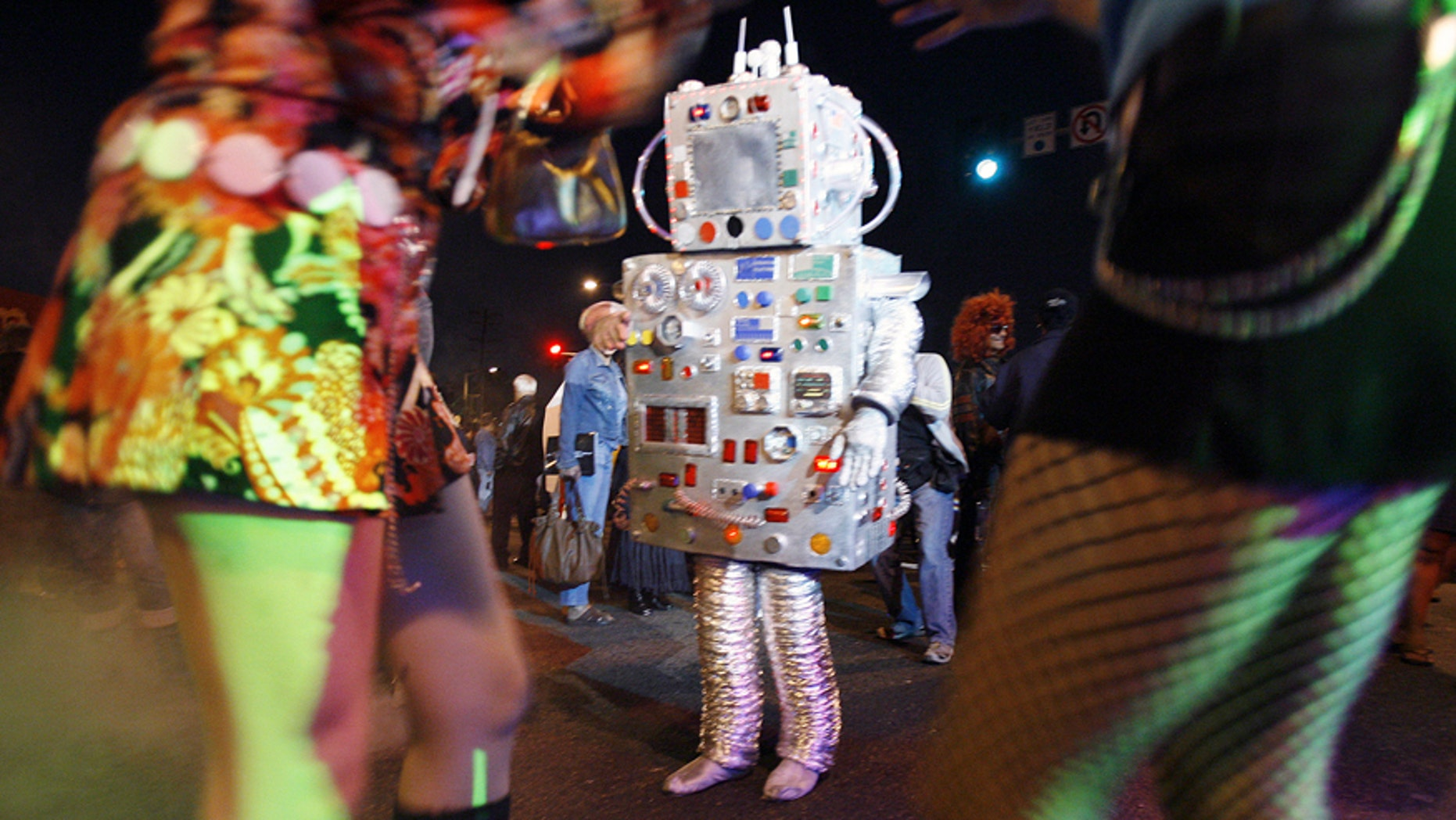 File photo: People in costume dance during the 19th annual Halloween costume carnaval in West Hollywood, California October 31, 2006. (REUTERS/Mario Anzuoni)