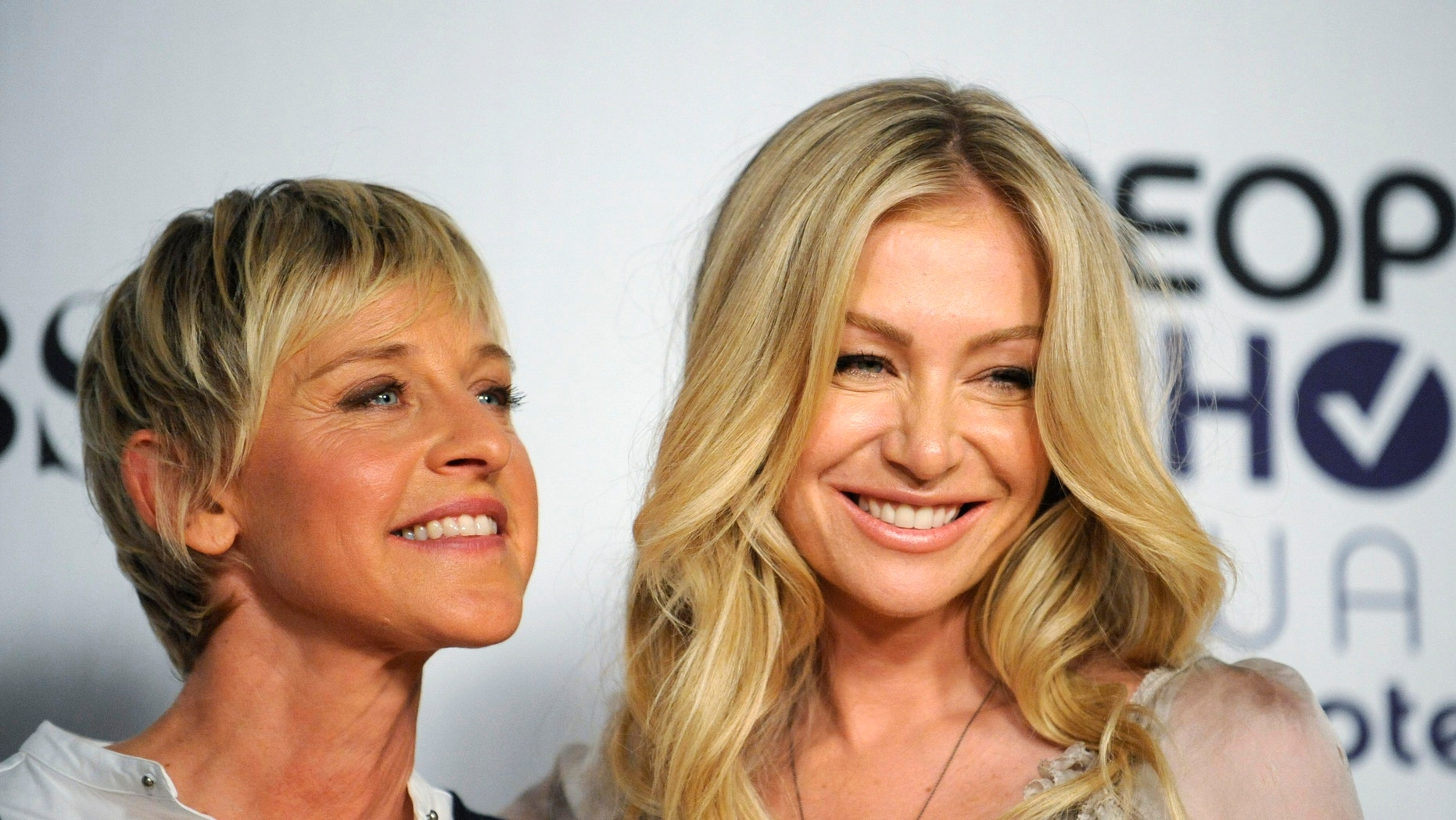 Comedian Ellen Degeneres and actress Portia de Rossi pose backstage after Degeneres won the award for Favorite Talk Show Host at the 35th annual People's Choice awards in Los Angeles January 7, 2009.