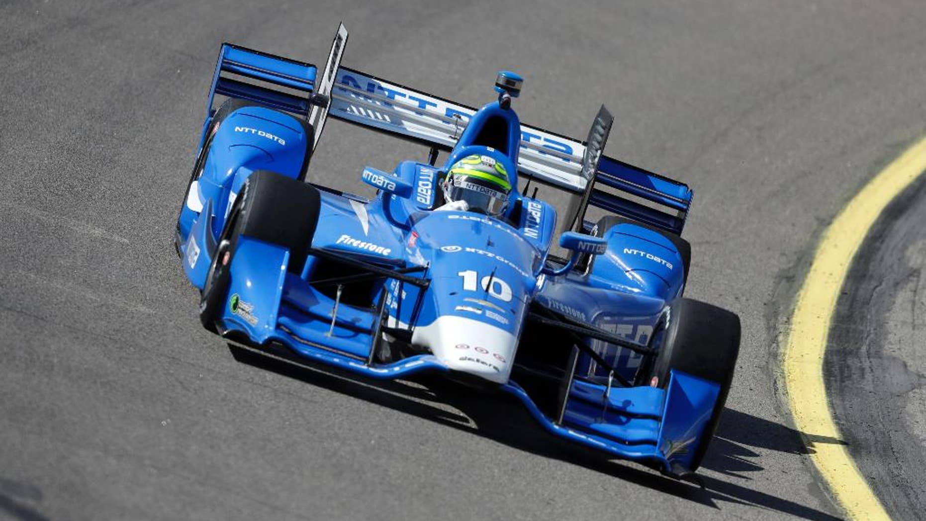 Tony Kanaan drives his car during practice for the IndyCar Series auto race Saturday, July 9, 2016, at Iowa Speedway in Newton, Iowa. (AP Photo/Charlie Neibergall)