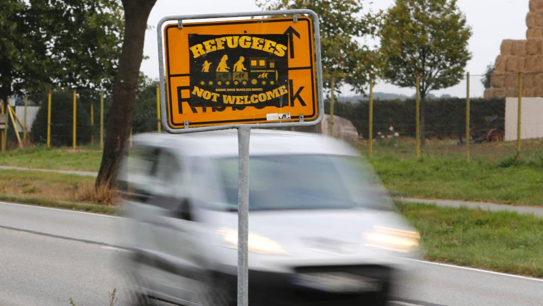 The Sept. 23, 2016 shows a poster 'Refugees not welcome' sticked on a city sign in the outskirts of Nauen, eastern Germany, one of several thousand hate crimes in Germany in 2016. (AP Photo/Ferdinand Ostrop)