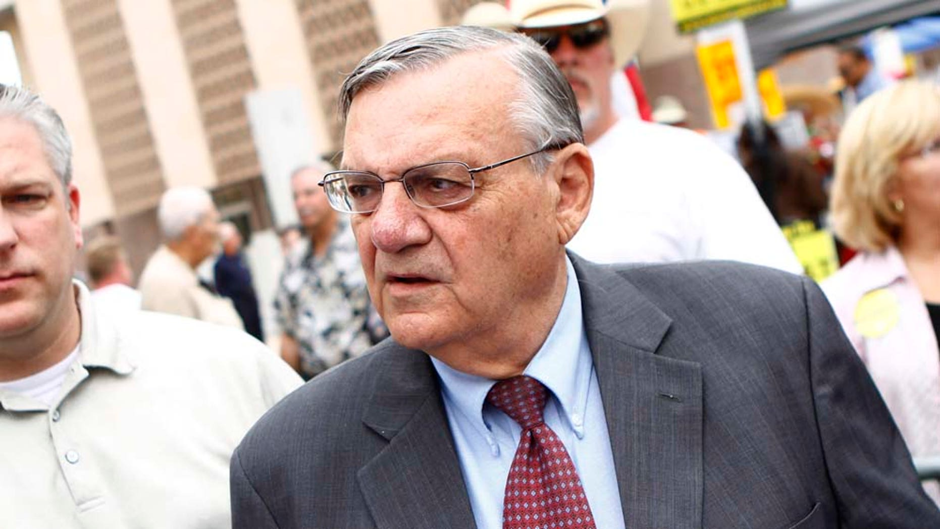 PHOENIX, AZ -  OCTOBER 22:  Maricopa County Sheriff Joe Arpaio (R) attends a rally for the Tea Party Express national tour October 22, 2010 in Phoenix, Arizona. The tour, part of an initiative to get conservatives elected to the House and Senate, will move across country and conclude on November 1, 2010 in Concord, New Hampshire the day before the contentious mid-term elections. (Photo by Joshua Lott/Getty Images)