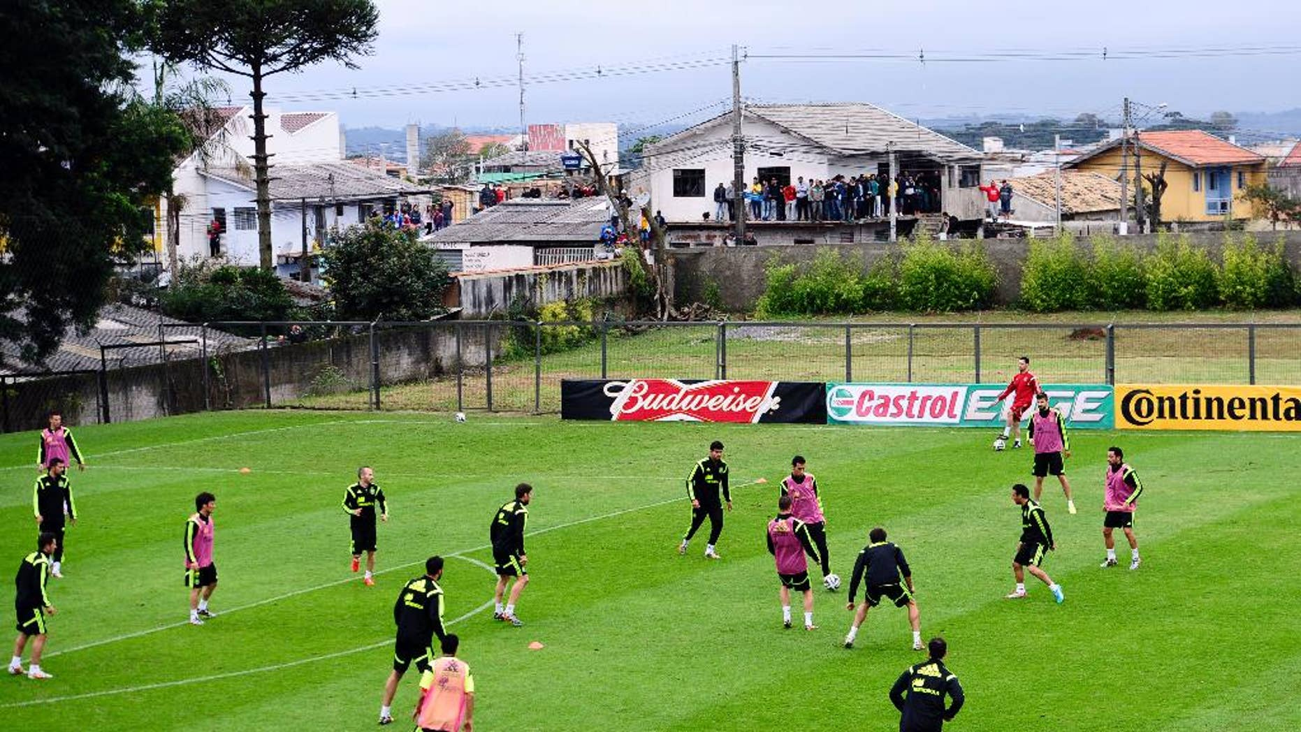Spanish national team players attend a training session at the Atletico Paranaense training center in Curitiba, Brazil, Tuesday, June 10, 2014. Spain will play in group B of the Brazil 2014 World Cup. (AP Photo/Manu Fernandez)