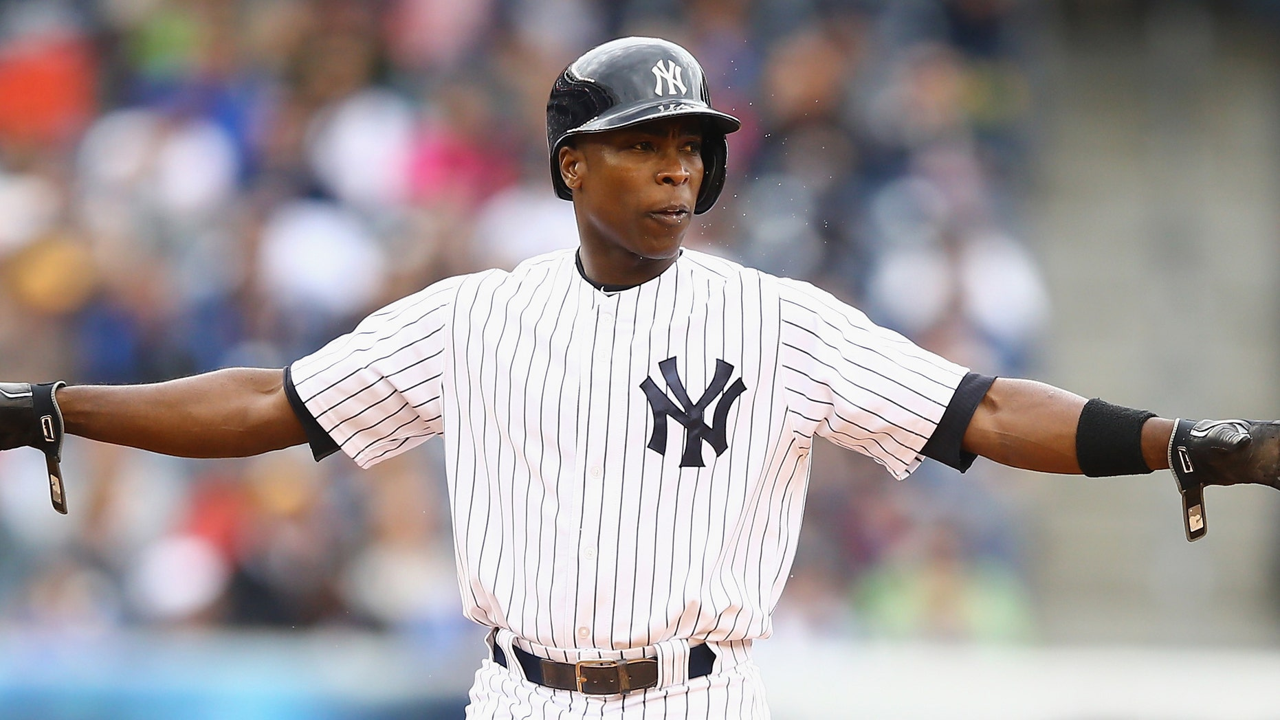 NEW YORK, NY - MAY 04: Alfonso Soriano #12 of the New York Yankees reacts after hitting a double against the Tampa Bay Rays  during their game at Yankee Stadium on May 4, 2014 in the Bronx borough of New York City.  (Photo by Al Bello/Getty Images)