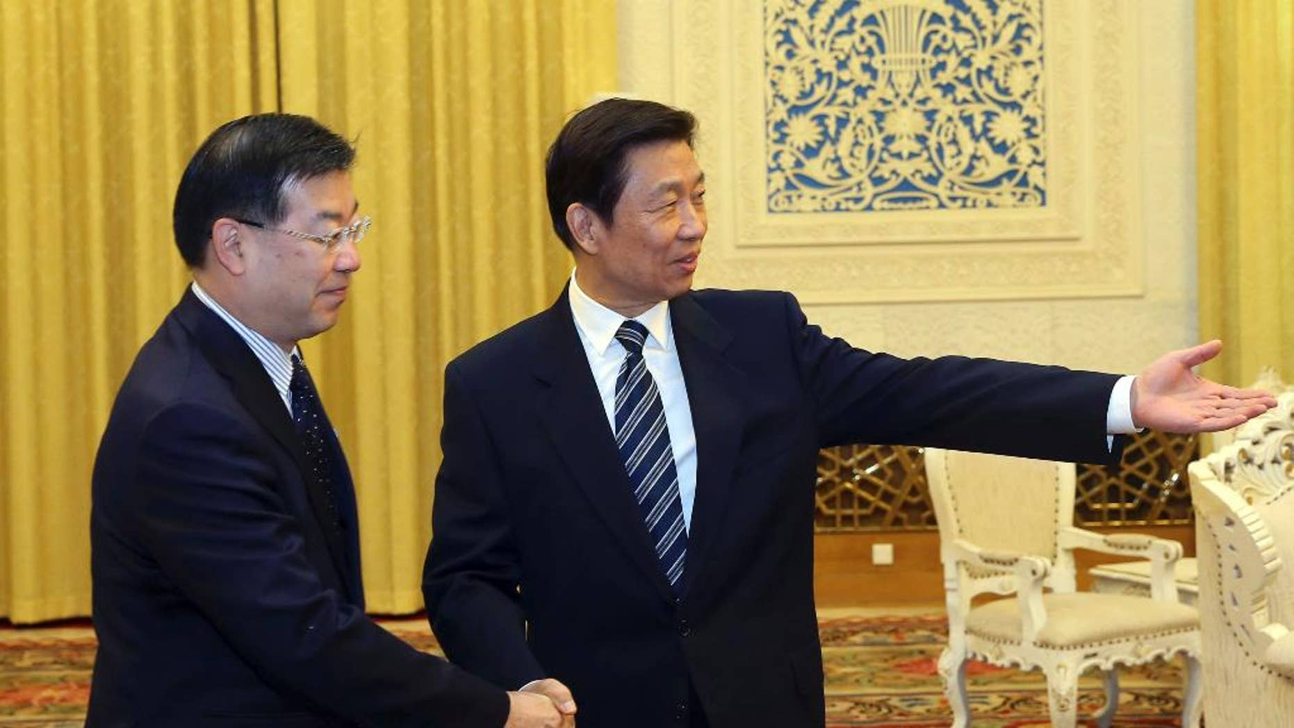 In this photo provided by China's Xinhua News Agency, Chinese Vice President Li Yuanchao, right,  meets with President of Japan's National Governors' Association, Keiji Yamada, in Beijing, capital of China, Tuesday, Oct. 28, 2014. China's vice president met Tuesday with a delegation of governors from Japan amid strained bilateral ties, a rare high-level meeting that points to Japan's hopes of a summit between the two countries' leaders at a regional conference next month. (AP Photo/Xinhua, Liu Weibing) NO SALES