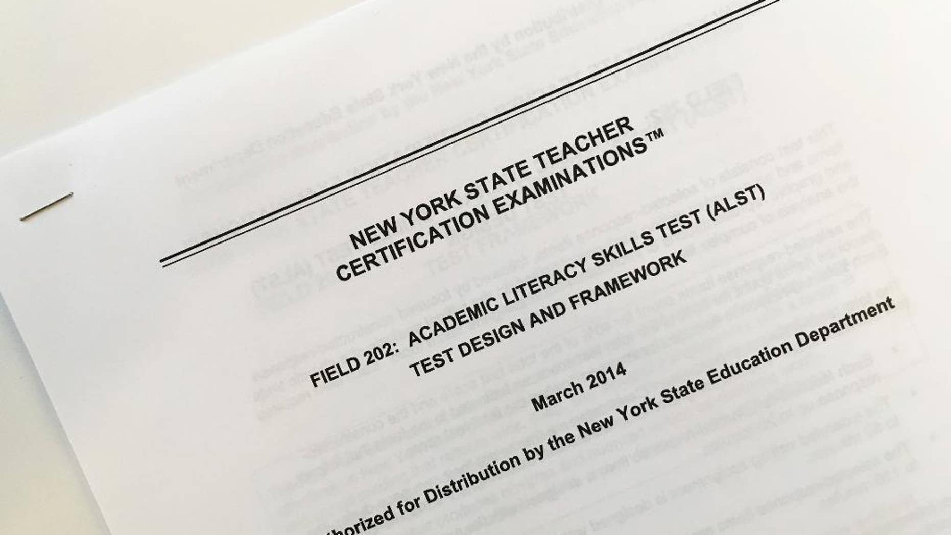 This March 8, 2017 photo shows the front page of a document explaining a certification exam known as the Academic Literacy Skills Test, designed to measure the reading and writing skills of aspiring teachers, in New York. New York state education officials are poised to scrap the test which critics say is racially biased, redundant and a poor predictor of who will succeed as teacher. But backers of the test say eliminating it could put weak teachers in classrooms. (AP Photo/Barbara Woike)