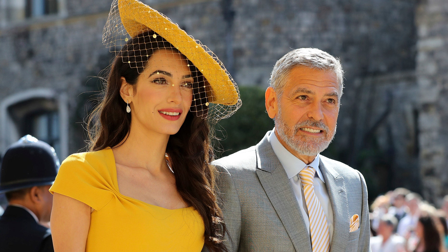 Amal Clooney and George Clooney attended Prince Harry and Meghan Markle at St. George's Chapel back in May, but did not make it to Princess Eugenie's October nuptials. (Gareth Fuller/pool photo via AP)<br>