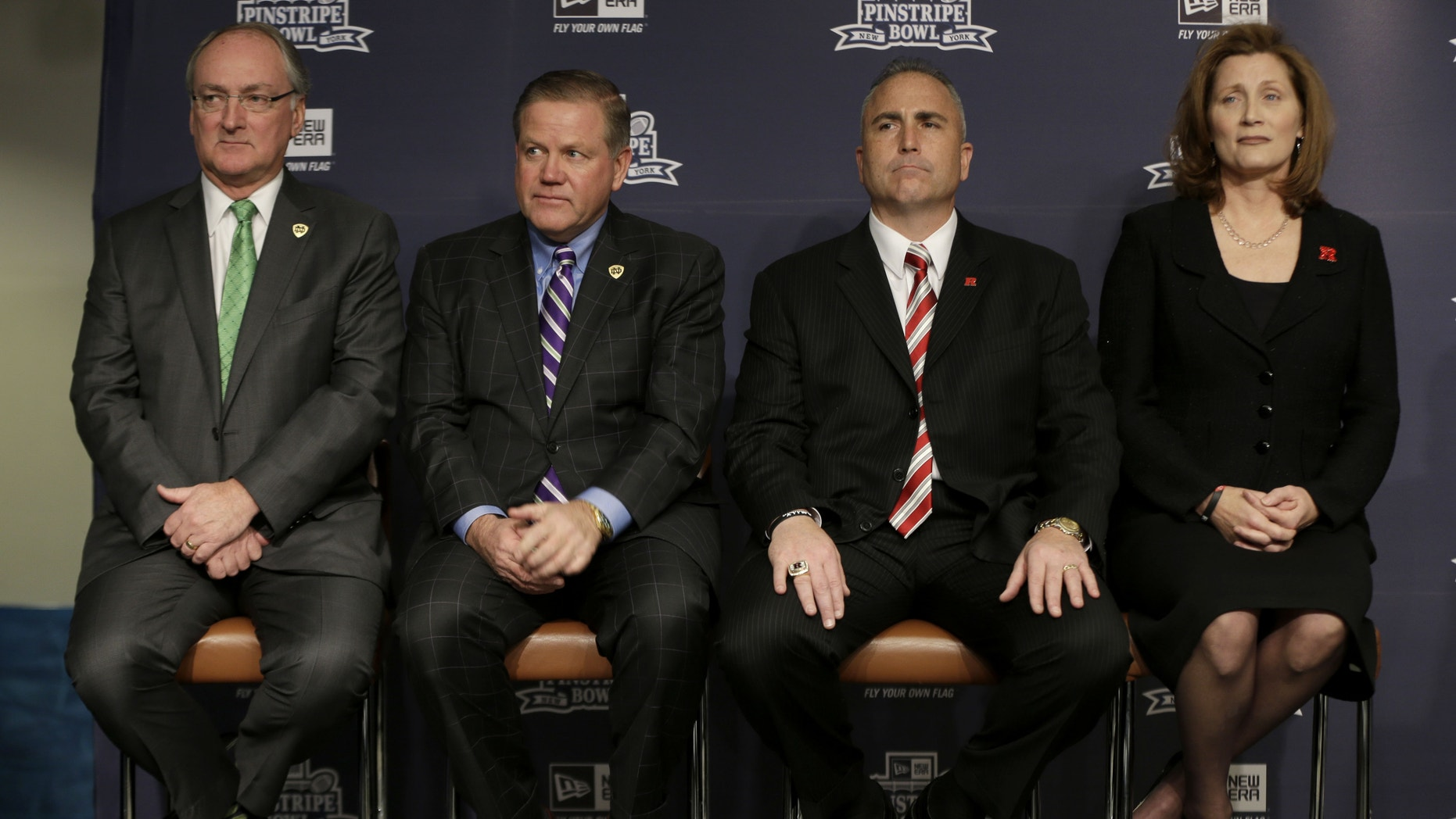 Notre Dame athletic director Jack Swarbrick, left, and head football coach Brian Kelly, second from left, along with Rutgers athletic director Julie Hermann, right, and head football coach Kyle Flood, attend an NCAA college football news conference in New York, Tuesday, Dec. 10, 2013. Rutgers and Notre Dame will face off at the Pinstripe Bowl at Yankee Stadium on Saturday, Dec. 28, 2013. (AP Photo/Seth Wenig)