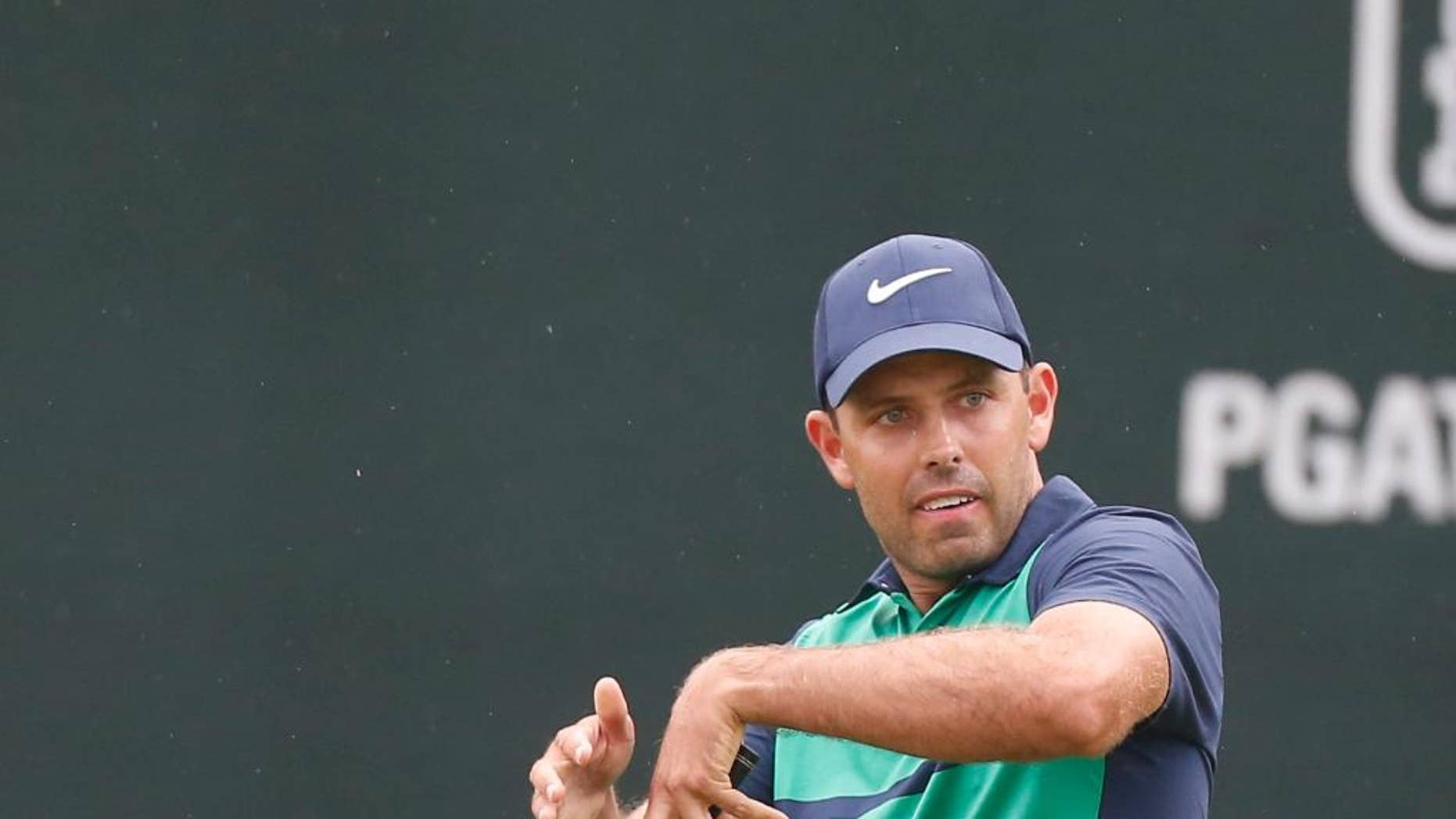 FILE - In this March 13, 2016, file photo, Charl Schwartzel, of South Africa, reacts as he misses his putt for birdie during regulation play on the 18th hole during the final round of the Valspar Championship golf tournament in Palm Harbor, Fla. Defending champion Charl Schwartzel has withdrawn from the Valspar Championship pro-am after 10 holes because of something that has never happened to him: He got hit by a golf ball. (AP Photo/Brian Blanco, File)