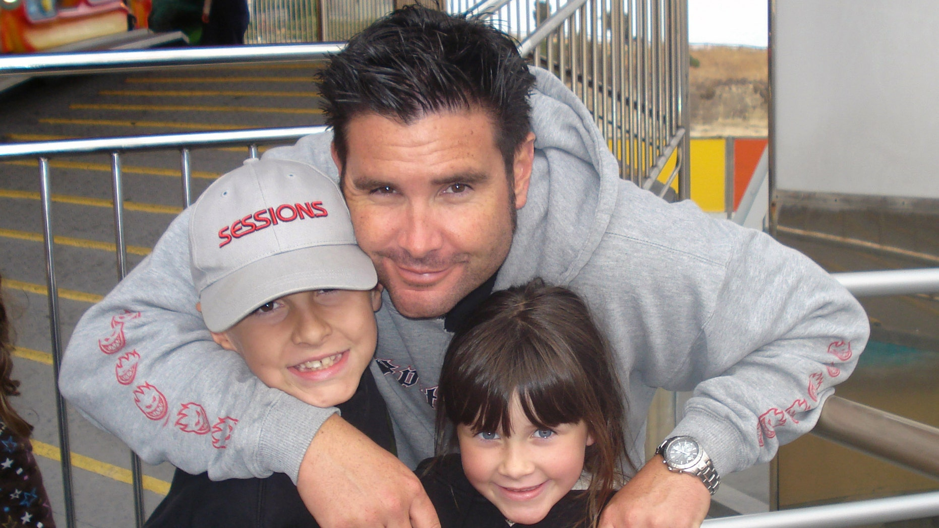 Undated photo of Bryan Stow holding his 12-year-old son and 8-year-old daughter.