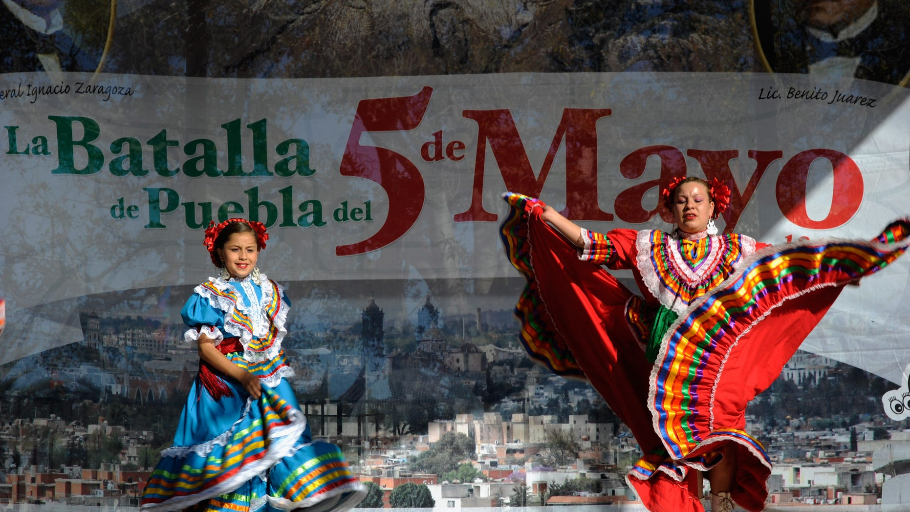 LOS ANGELES, CA - MAY 05:  Aracely Saucillo (L) and Marylin Castillo perform with Mexica Ballet Folclorico performs during Cinco De Mayo festivities on May 5, 2011 at El Pueblo de Los Angeles Historic Site on Olvera Street in downtown Los Angeles, California. Cinco de Mayo celebrates the 1862 Mexican victory over the French in the Battle of Puebla.  (Photo by Kevork Djansezian/Getty Images)