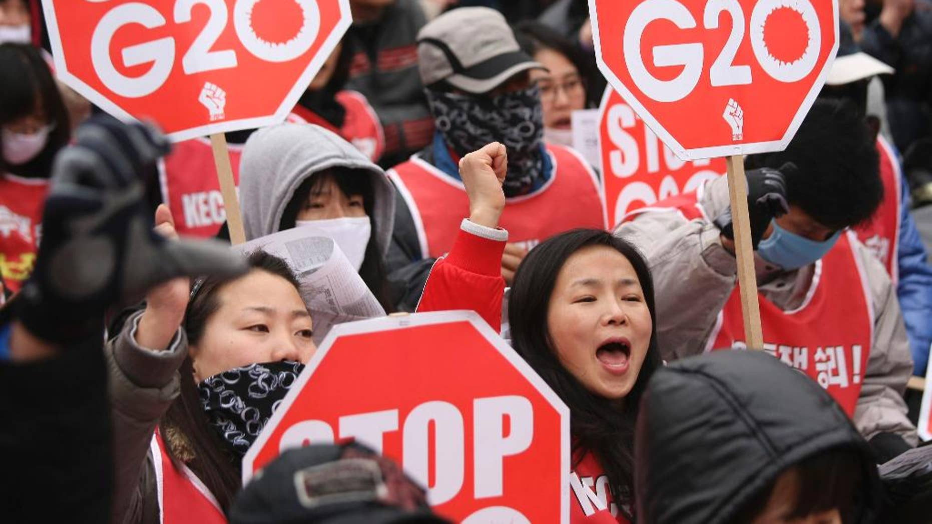 FILE - In this Thursday, Nov. 11, 2010 file photo, protesters gather to denounce the G-20 Summit. Since 2010, the G-20 has issued two-year action plans on anti-corruption efforts, and a report on what has been achieved under the last plan is expected at this weekend's summit. The leaders will also issue a new plan for 2015-16, which is expected to include commitments on issues such as foreign bribery, stolen asset recovery and whistleblower protection, said A.J. Brown, a director with Transparency International Australia. (AP Photo/Wally Santana, File)