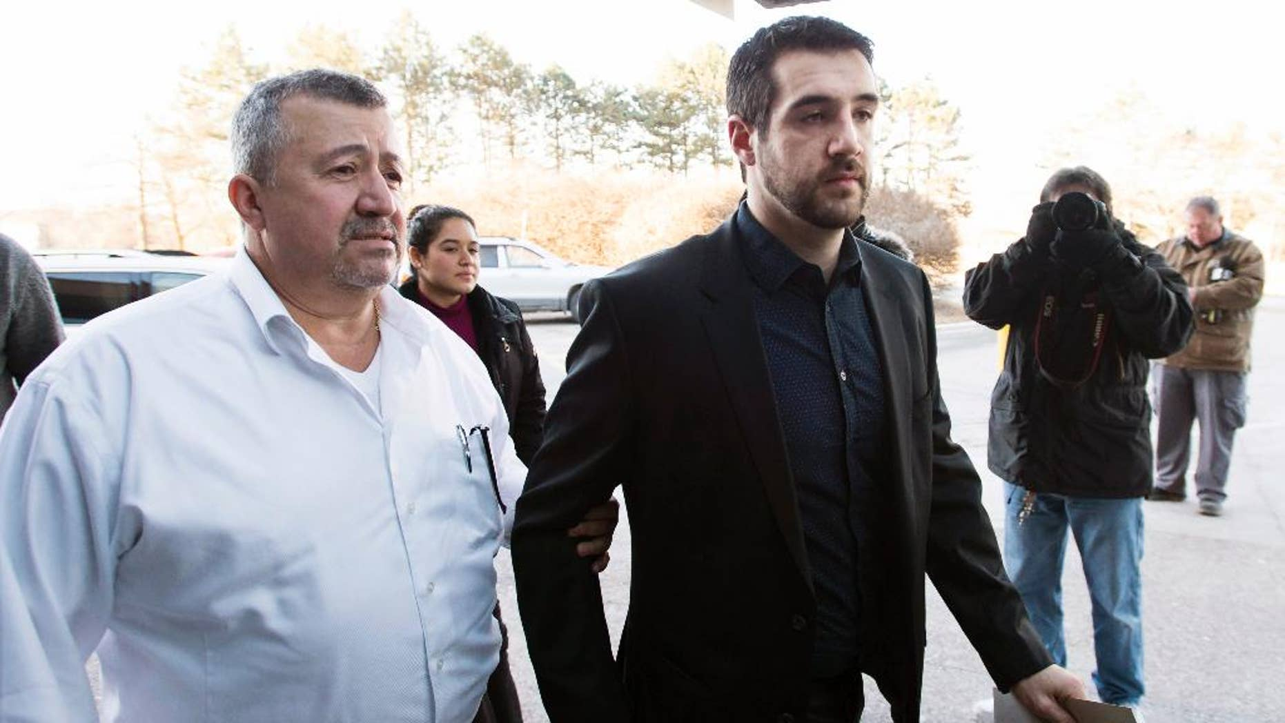 FILE - In this Feb. 23, 2016 file photo, Marco Muzzo, right, arrives with family at the court house for his sentencing hearing in Newmarket, Ontario. A judge has sentenced Muzzo to 10 years in prison for killing three young children and their grandfather while driving drunk.(Nathan Denette/The Canadian Press via AP) MANDATORY CREDIT