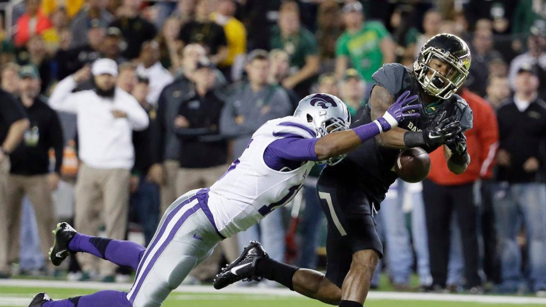 Kansas State defensive back Randall Evans (15) breaks up a pass intended for Baylor's Corey Coleman (1) in the first half of an NCAA college football game, Saturday, Dec. 6, 2014, in Waco, Texas. (AP Photo/Tony Gutierrez)
