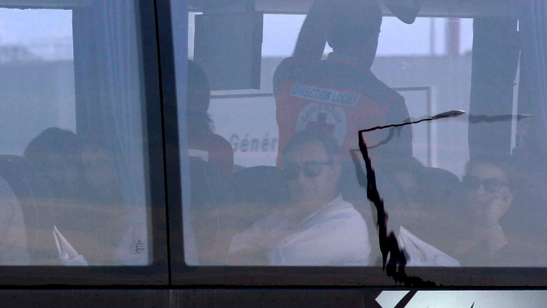 Relatives of victims in a bus after their arrival at Marseille airport, southern France, Thursday March 26, 2015.