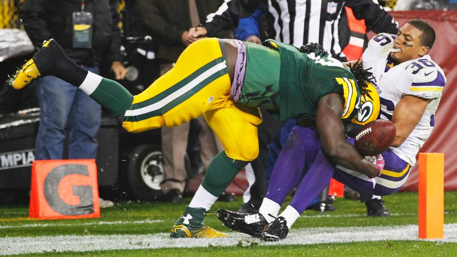 Green Bay Packers' Eddie Lacy gets past Minnesota Vikings' Robert Blanton (36) for a 10-yard touchdown run during the second half of an NFL football game Thursday, Oct. 2, 2014, in Green Bay, Wis. (AP Photo/Mike Roemer)