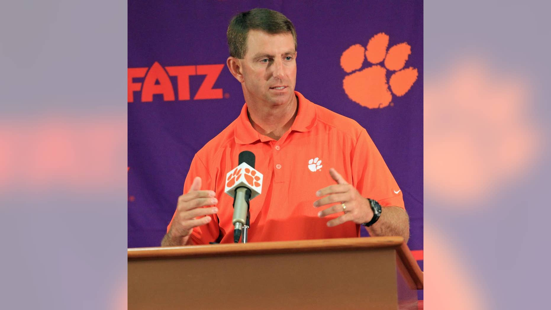 Clemson head coach Dabo Swinney discusses the Tigers' NCAA college football 2014 season at Memorial Stadium in Clemson, S.C. on Tuesday, Aug. 26, 2014. Clemson opens the season at Georgia on Aug. 30. (AP Photo/Anderson Independent-Mail, Mark Crammer)