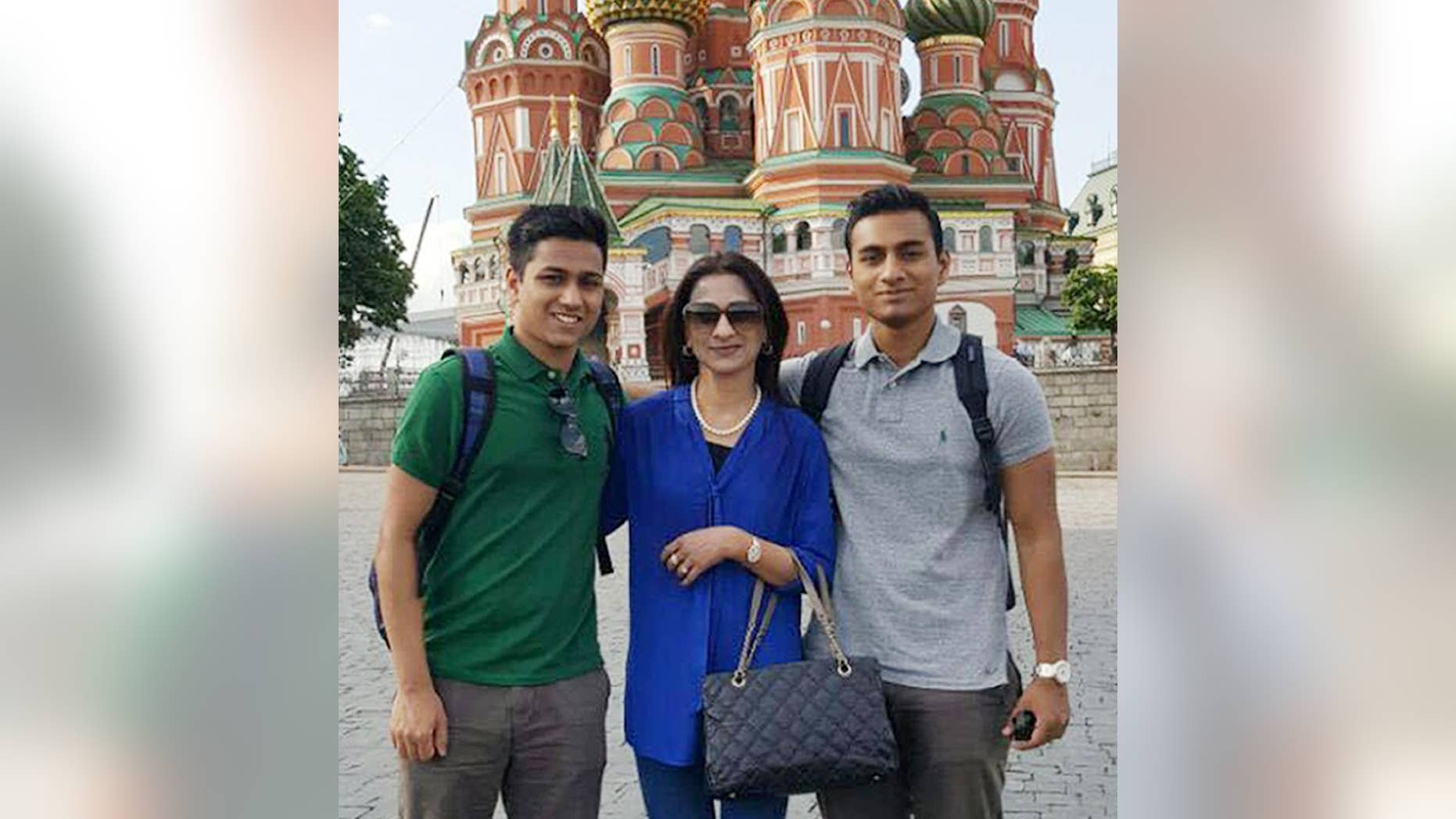 This May 26, 2016, photo, provided by the Hossain Family shows Faraaz Hossain, left, mother, Simeen, center, and brother, Zaraif, right, in Moscow, Russia. When Faraaz Hossain's family received his body after the deadly siege at the Holey Artisan Bakery in Dhaka, Bangladesh, on July 2, 2016, they noticed the palm of his right hand had been sliced clean through. The wound suggested the 20-year-old Faraaz, the family's beloved youngest child, had grabbed the attacker's sword and tried to fight back. (Hossain Family photo via AP)