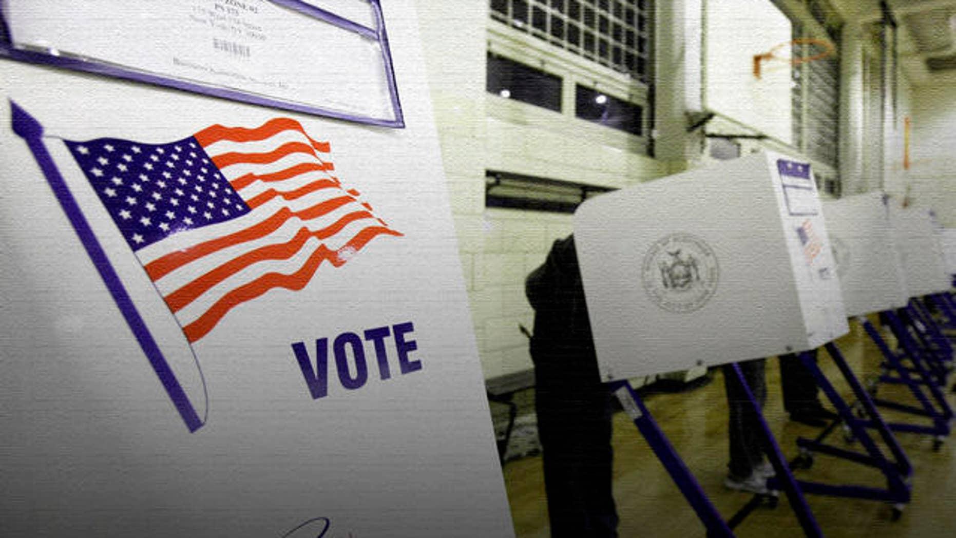 Voters cast their ballots in a school gym in New York's Harlem neighborhood,  Tuesday, Nov. 2, 2010. (AP Photo/Richard Drew)