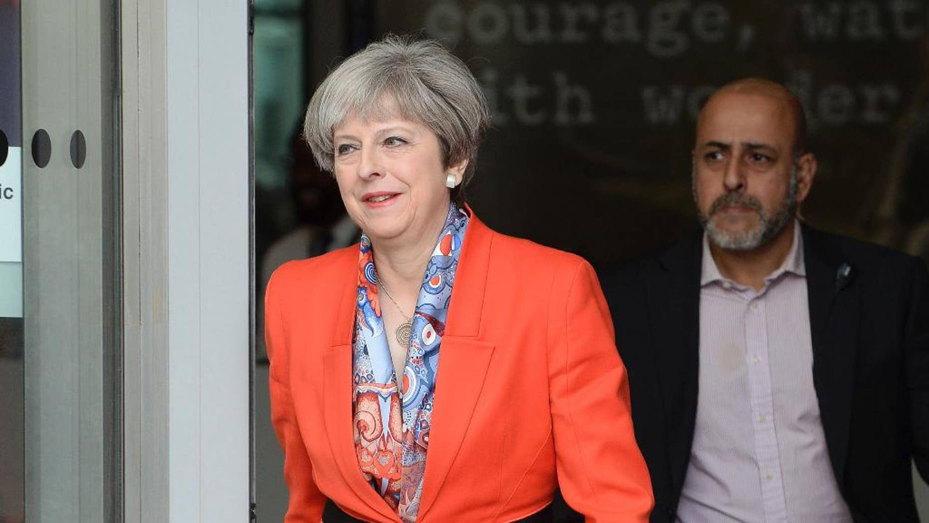 Prime Minister Theresa May leaves BBC studios in London after appearing on a morning show Sunday April 30, 2017. Britain goes to the polls for a General Election on upcoming June 8. ( John Stillwell/PA via AP)
