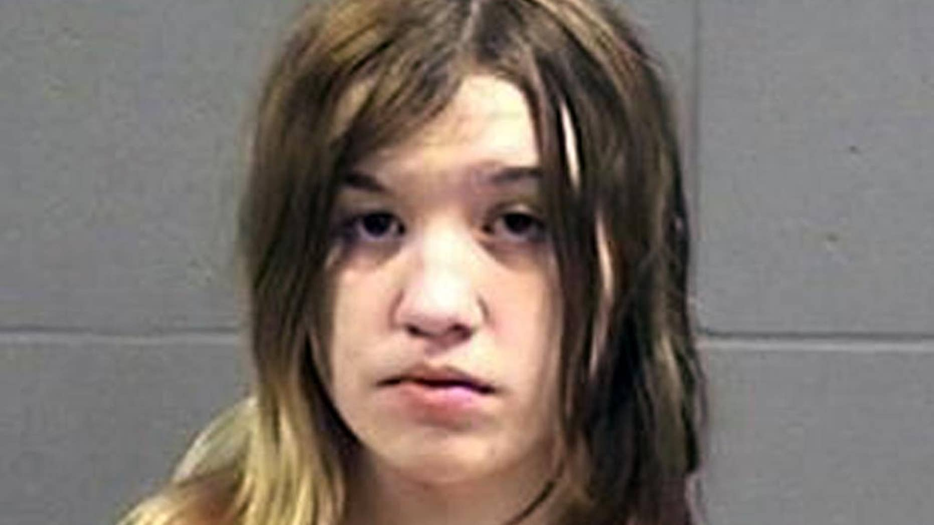 This photo provided Friday, April 24, 2014 by the Oneida County, Wisconsin, Sheriff's Office shows Ashlee Martinson, 17. Martinson is is charged with fatally stabbing her mother Jennifer Ayers, 40,  and shooting her stepfather Thomas Ayers, 37, on March 8 at the family's home in the Town of Piehl, Wis. (Oneida County Sheriff's Office via AP)