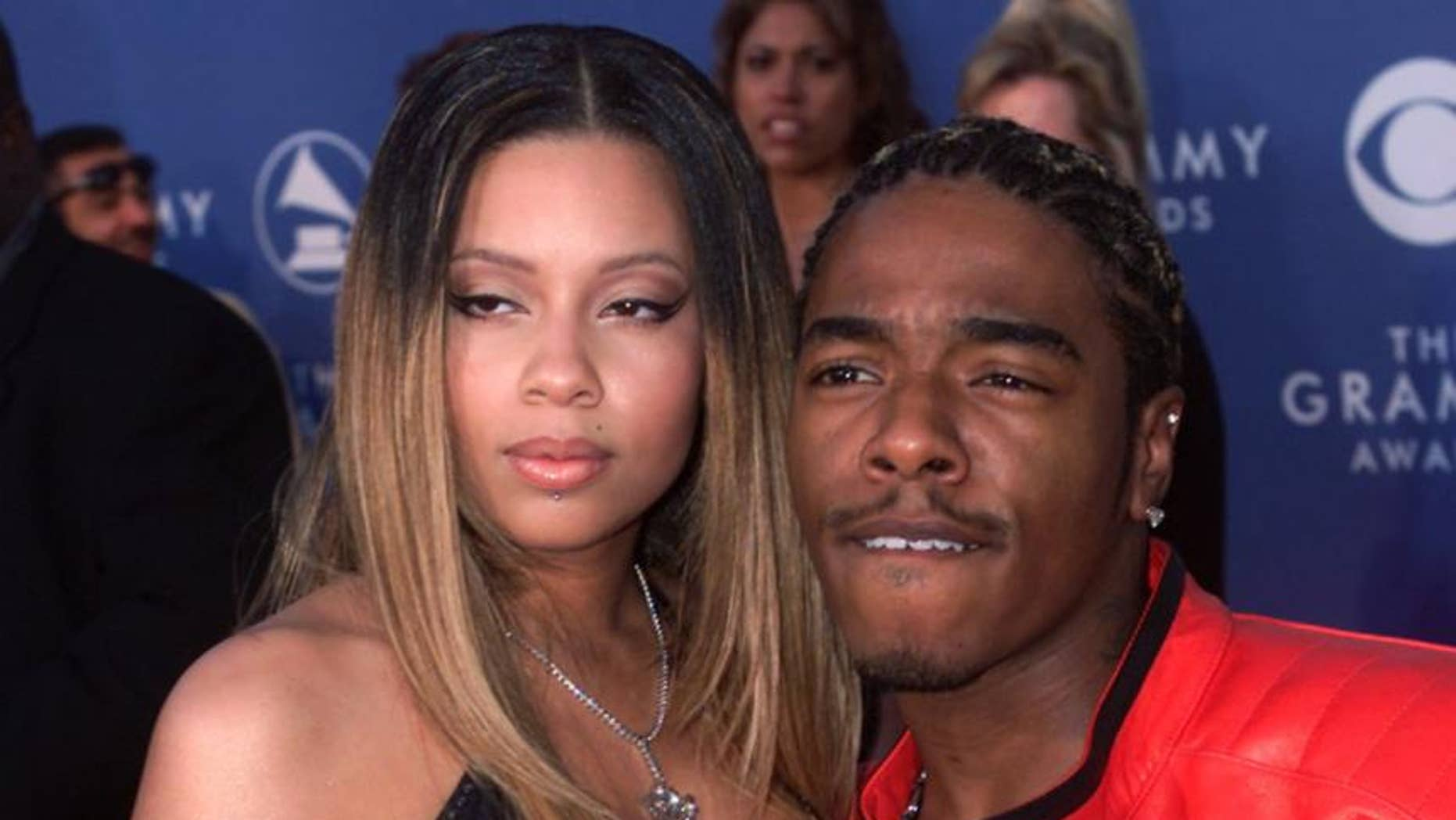 Rapper Sisqo (right) and his girlfriend Tara arrive at the 43rd annual Grammy Awards in Los Angeles on February 21, 2001.