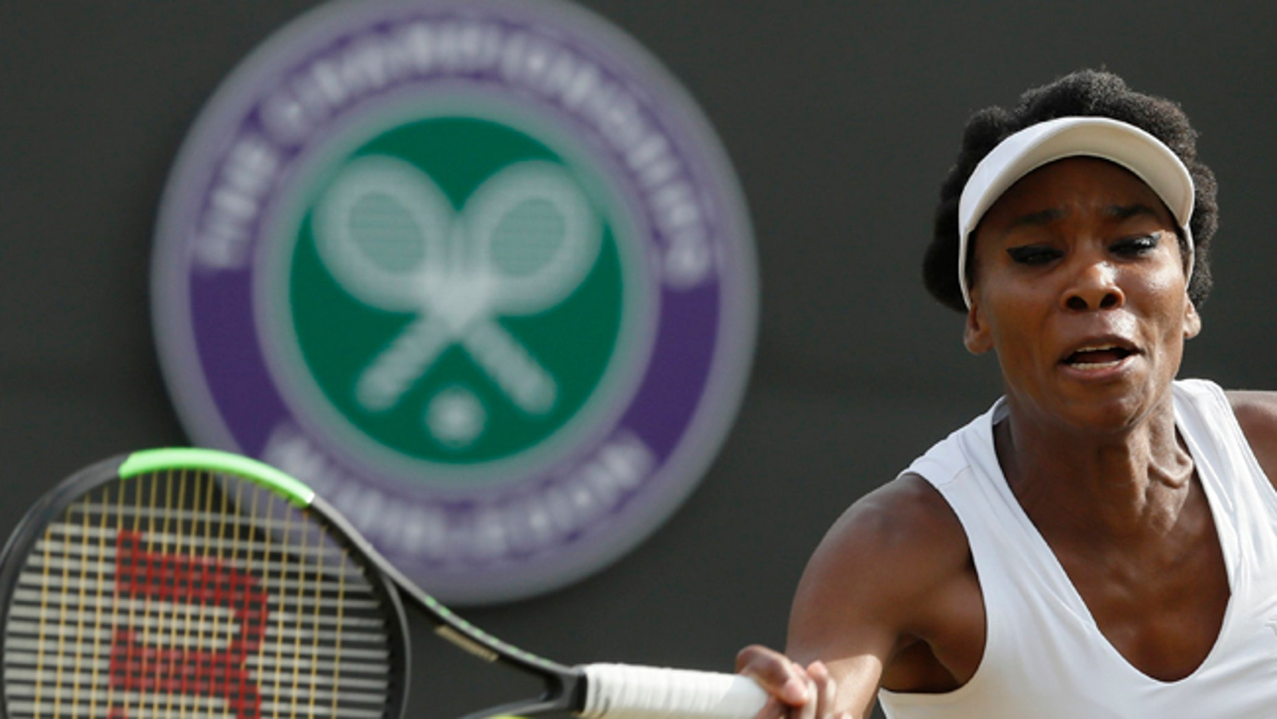 Venus Williams of the United States returns to Japan's Naomi Osaka during their Women's Singles Match on day five at the Wimbledon Tennis Championships in London Friday, July 7, 2017. (AP Photo/Kirsty Wigglesworth)