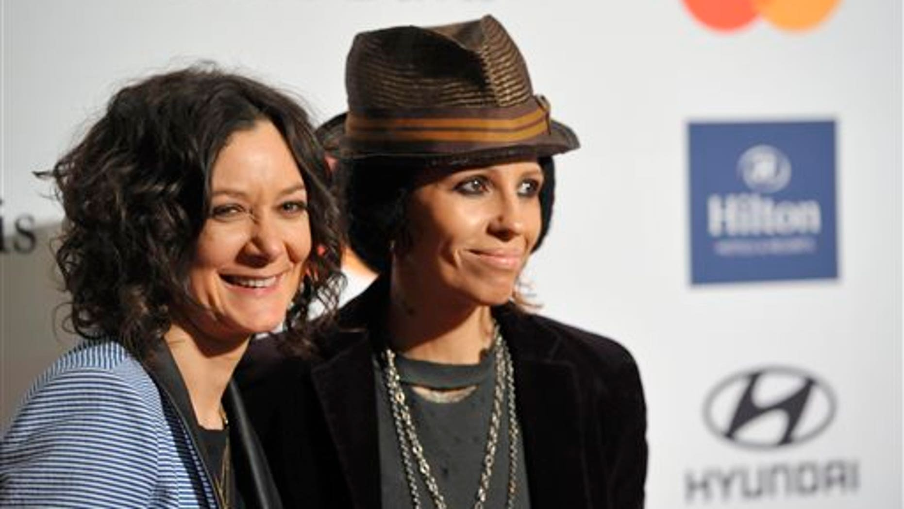 FILE - In this Feb. 9, 2013 file photo, actress Sara Gilbert, left, and recording artist Linda Perry arrive at the Clive Davis Pre-GRAMMY Gala in Beverly Hills, Calif. A spokeswoman for Gilbert says the actress and musician were wed over the weekend. Melissa Kates confirmed the nuptials Monday, March 31, 2014. (Photo by John Shearer/Invision/AP, file)