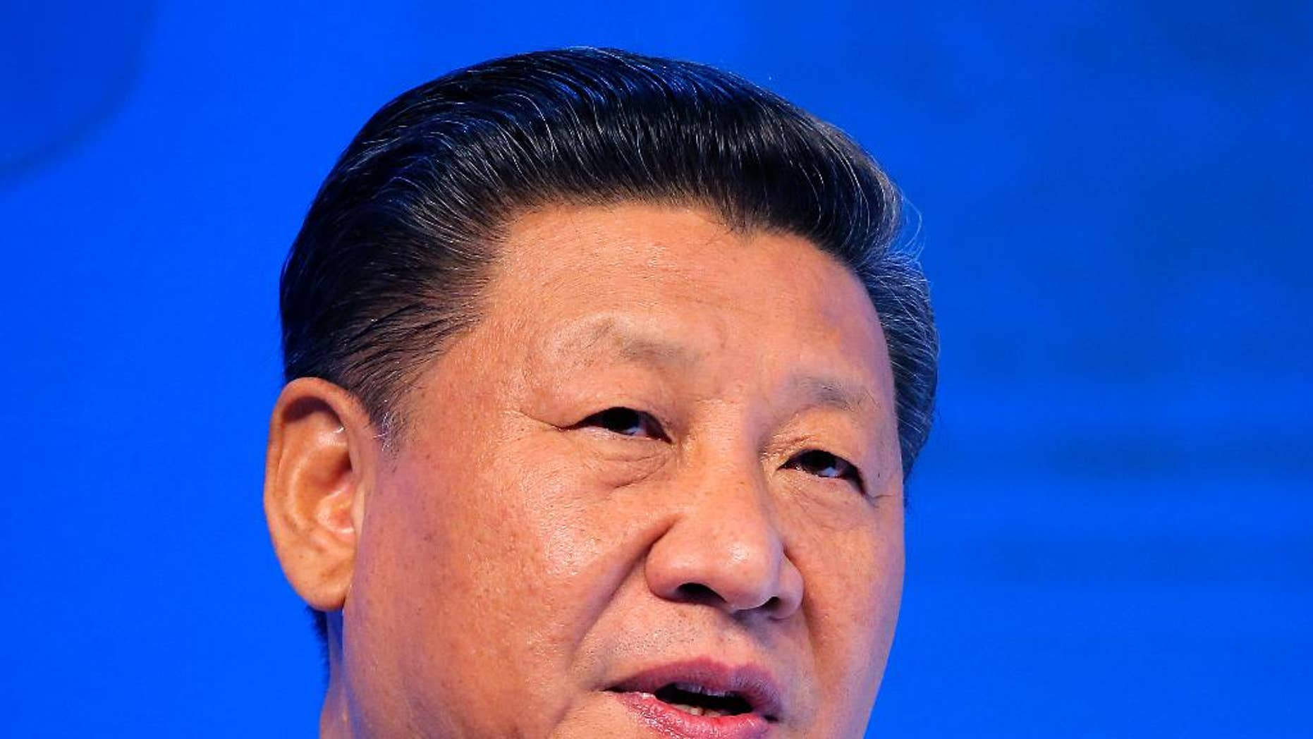 """FILE - In this  Jan. 17, 2017, file photo, Chinese President Xi Jinping speaks at the World Economic Forum in Davos, Switzerland. U.S. President Donald Trump has reaffirmed America's long-standing """"one China"""" policy in a telephone conversation with Xi that could alleviate concerns about a major shift in Washington's approach to relations with Beijing. The long-awaited call came Thursday, Feb. 9, 2017, Washington time, the White House and China's state broadcaster CCTV said. (AP Photo/Michel Euler, File)"""