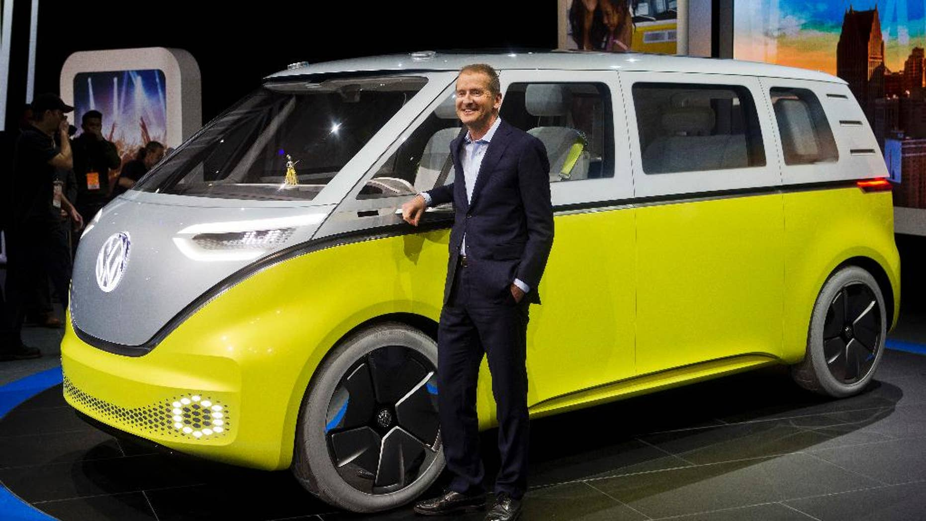 Dr. Herbert Diess, chairman of the Volkswagen brand, poses with the I.D. Buzz all-electric concept van, at the North American International Auto Show, Monday, Jan. 9, 2017, in Detroit. (AP Photo/Tony Ding)