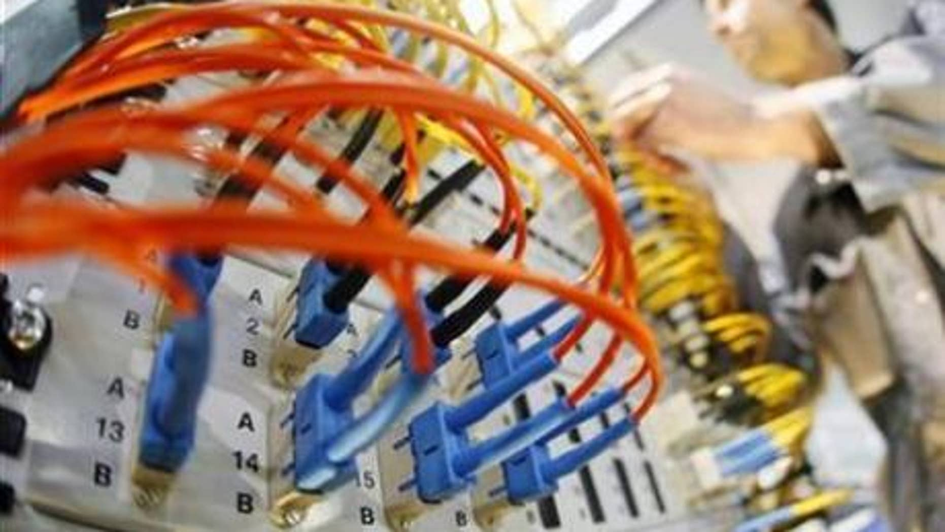 A worker prepares a server in a file photo.