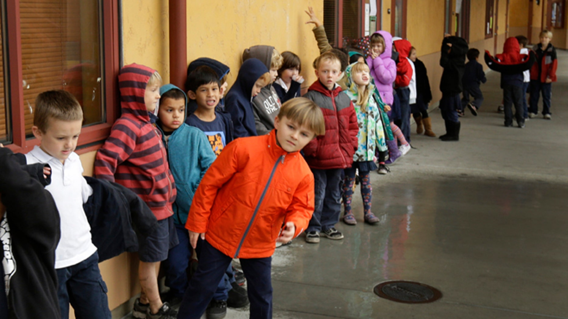 Jan. 24, 2013: A first grade class of 30 children waits to enter a classroom at the Willow Glenn Elementary School in San Jose, Calif.