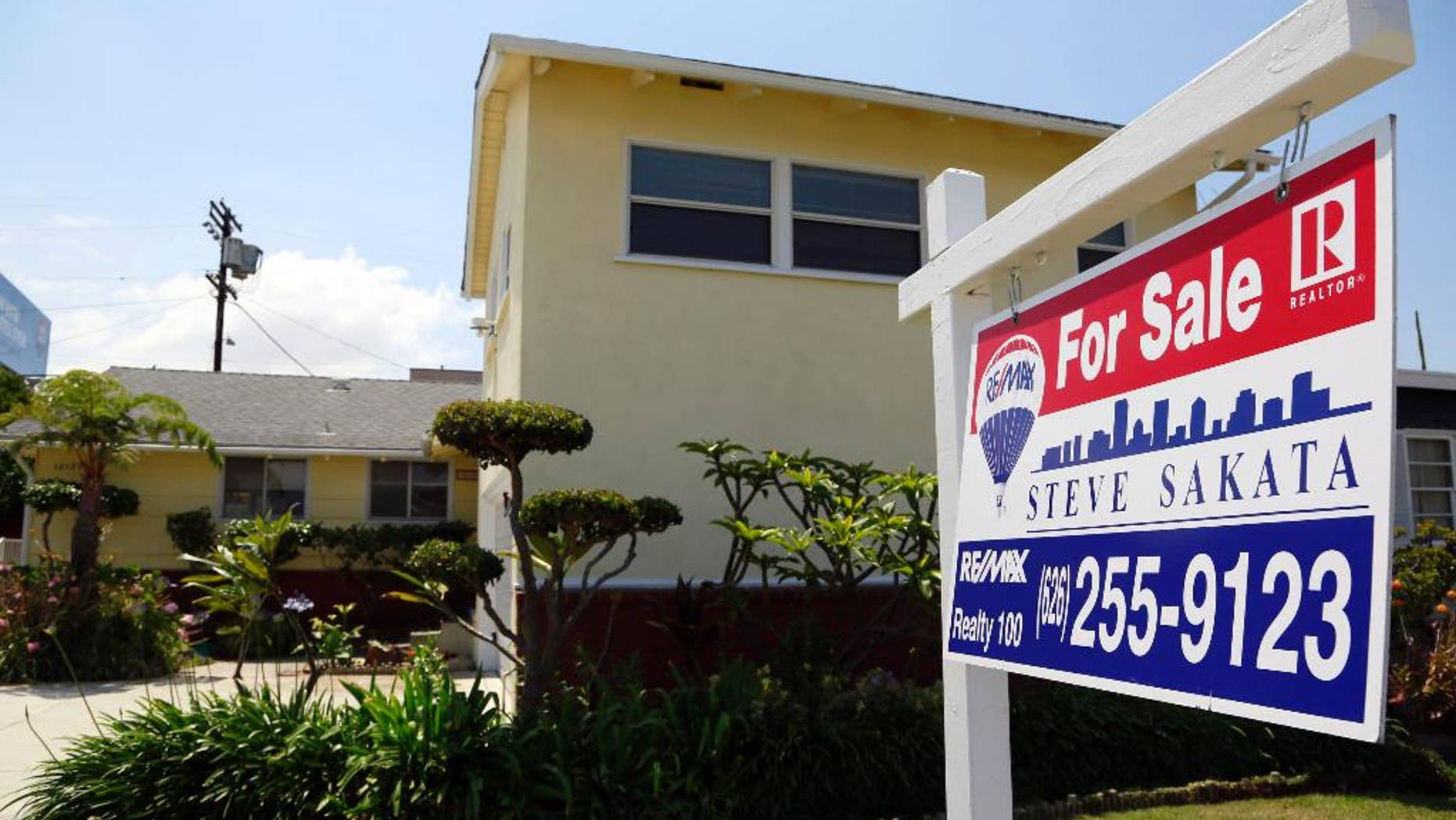 This Thursday, May 21, 2015 photo shows a house for sale in Culver City, Calif. Freddie Mac reports on average U.S. mortgage rates on Thursday, May 28, 2015. (AP Photo/Nick Ut)