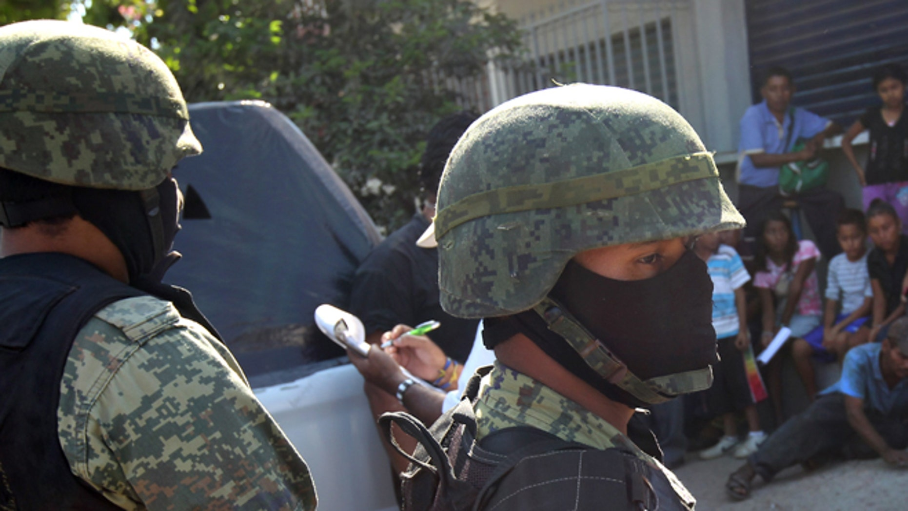 ACAPULCO, MEXICO - MARCH 03:  Mexican marines stand guard at the site of a suspected drug-related execution on March 3, 2012 near Acapulco, Mexico. Drug violence has surged in the coastal resort in the last year, making Acapulco the second most deadly city in Mexico after Juarez. One of Mexico's top tourist destinations, Acapulco has suffered a drop in business, especially from foreign tourists, due to the violence. Toursim accounts for about 70 percent of the economy of Acapulco's state of Guerrero and 9 percent of Mexico's economy.  (Photo by John Moore/Getty Images)