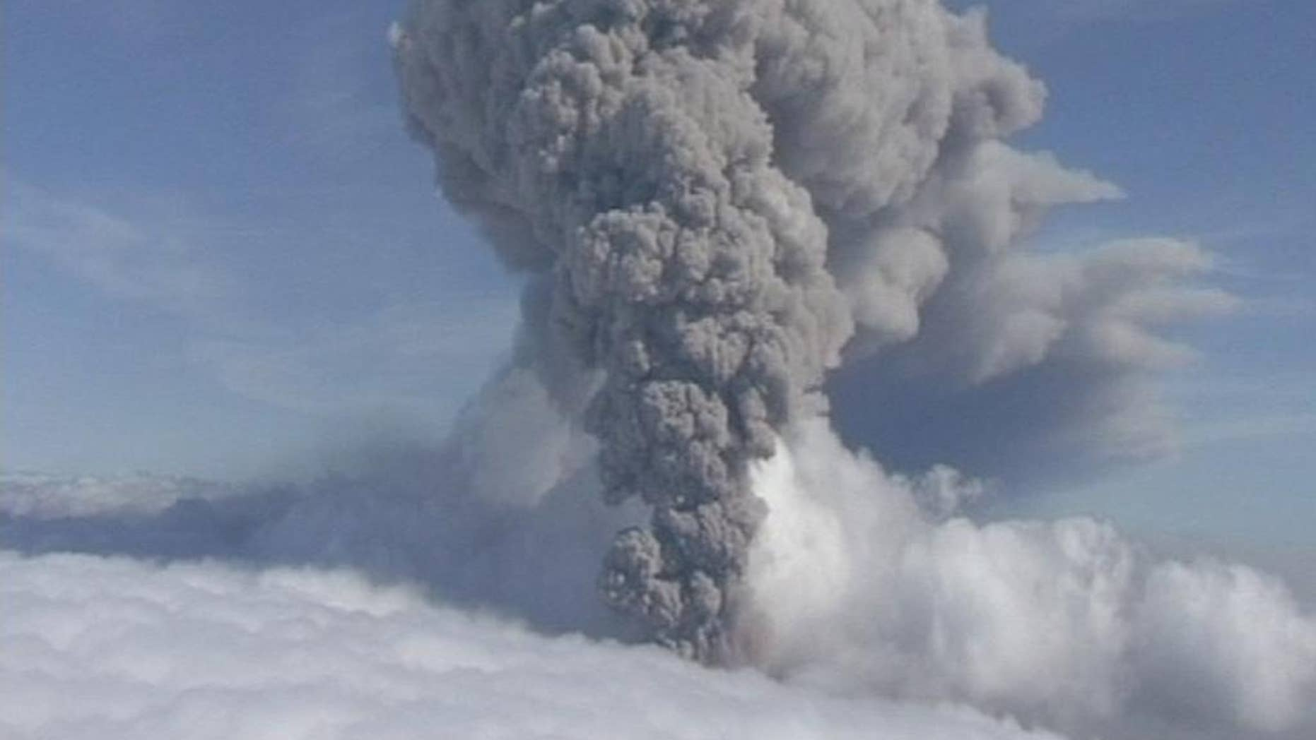 FILE  This is a  Saturday May 8 2010 file image taken from video of a column of ash rising from Iceland's Eyjafjallajokul volcano. It was reported Tueday Aug. 19, 2014 that thousands of small intense earthquakes are rocking Iceland amid concerns that one of the country's volcanoes may be close to erupting.   Iceland has raised its aviation alert level for the risk of a possible volcanic eruption to orange _ the second-most severe level. The alert is worrisome because of the chaos that followed the April 2010 eruption of Eyjafjallajokul, when more than 100,000 flights were cancelled because volcanic ash floating in the atmosphere is considered an aviation safety hazard. (AP Photo/ APTN) **