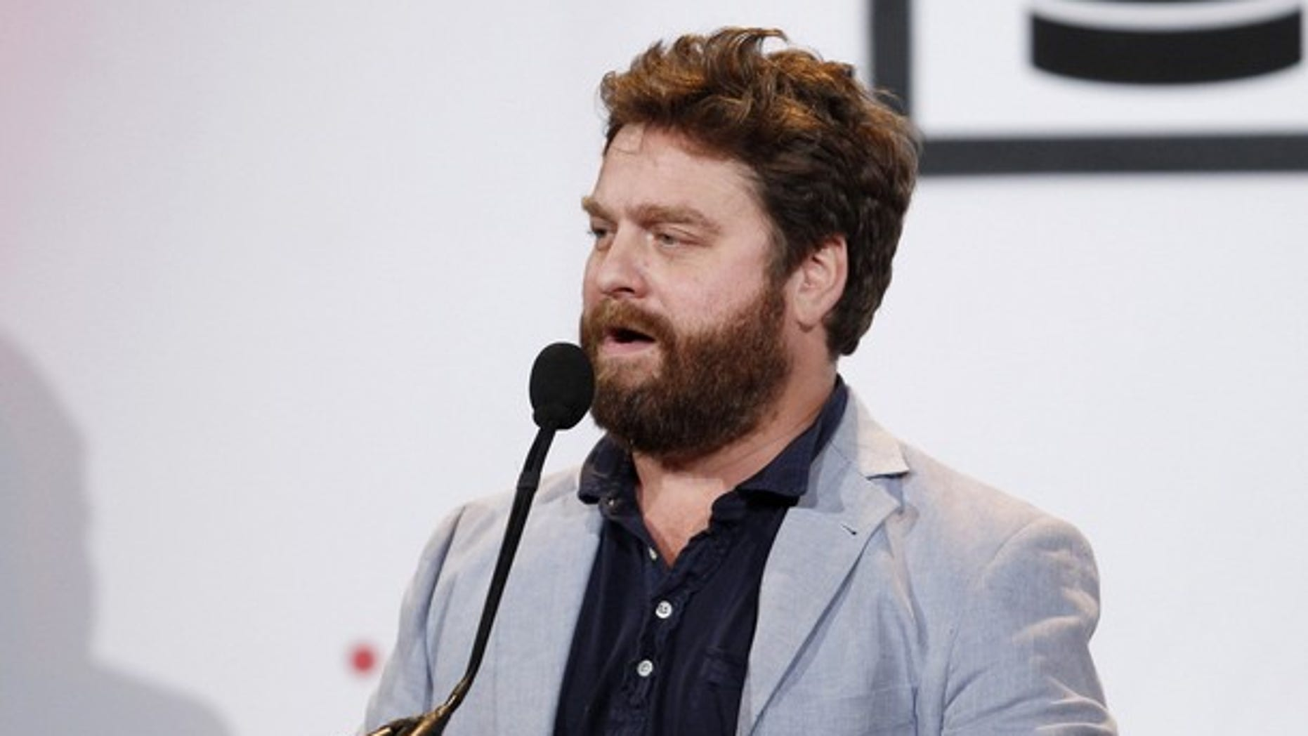 Actor Zach Galifianakis accepts an award for Best Comedy site at the Webby Awards in New York June 14, 2010.