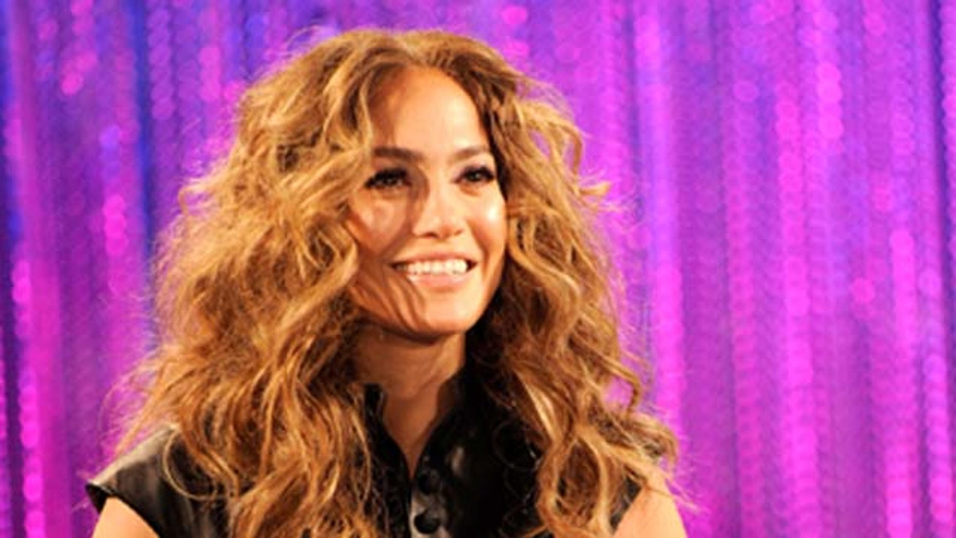 MAY 3, 2011: Jennifer Lopez signs CD covers for fans to celebrate her new album 'LOVE?' held at the Hard Rock Cafe Hollywood in Hollywood, Calif.