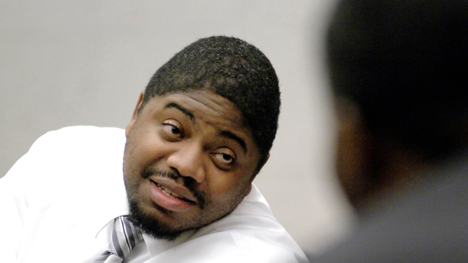FILE - In an Oct. 28, 2008 file photo, defendant Michael Addison talks with a member of the gallery during a break in his capital murder trial in the death of Manchester Police Officer Michael Briggs, in Hillsborough County Superior Court in Manchester, N.H. Addison was sentenced to death in 2008 for Briggs' murder. On Wednesday, Nov. 6, 2013, New Hampshire's Supreme Court will rule on the constitutionality of the state's death penalty and whether the death sentence of Addison will stand. (AP Photo/Union Leader, Bob LaPree, Pool, File)