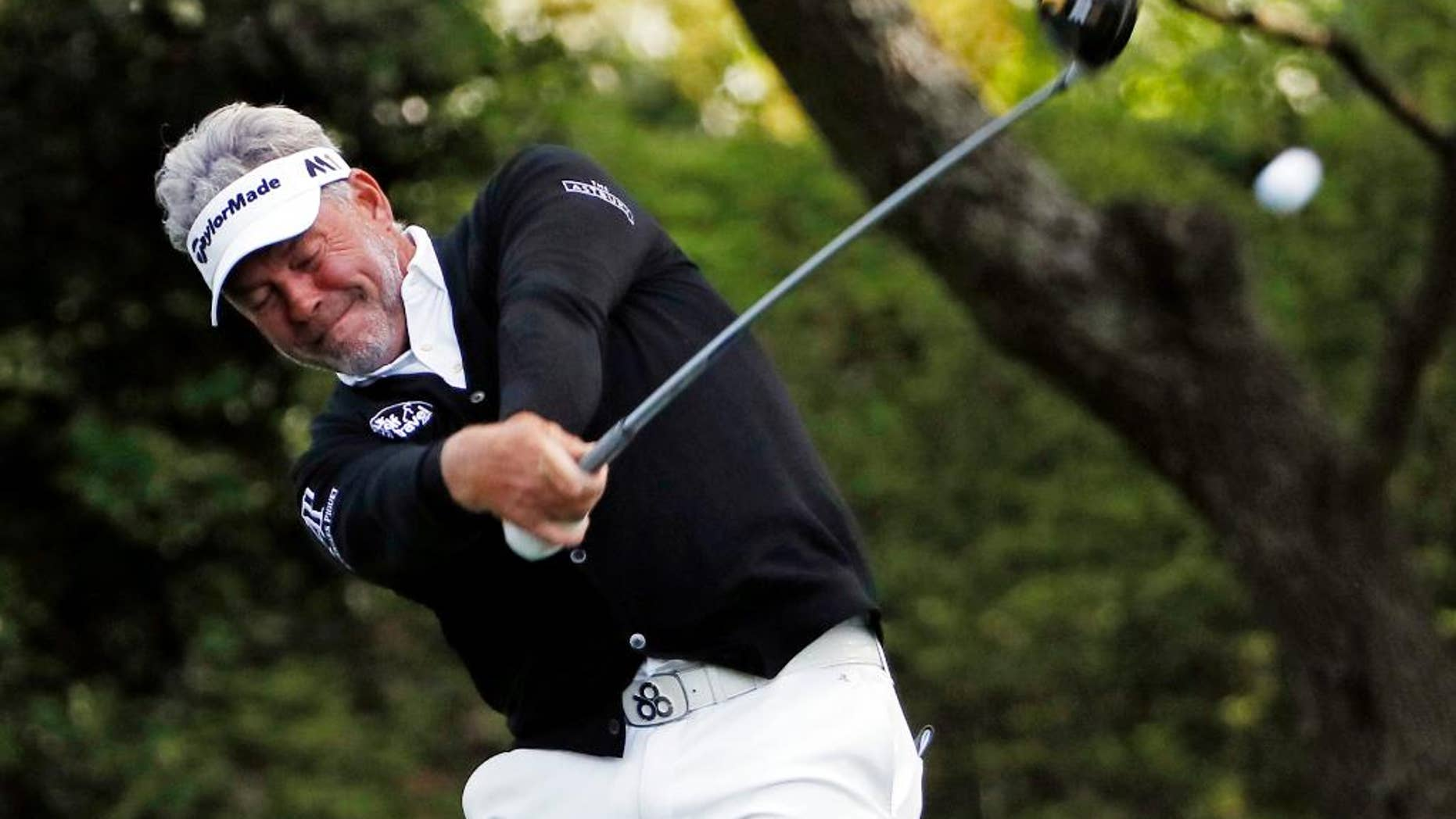 Darren Clarke, of Northern Ireland,  tees off on the second hole during the second round of the Masters golf tournament Friday, April 8, 2016, in Augusta, Ga. (AP Photo/David J. Phillip)