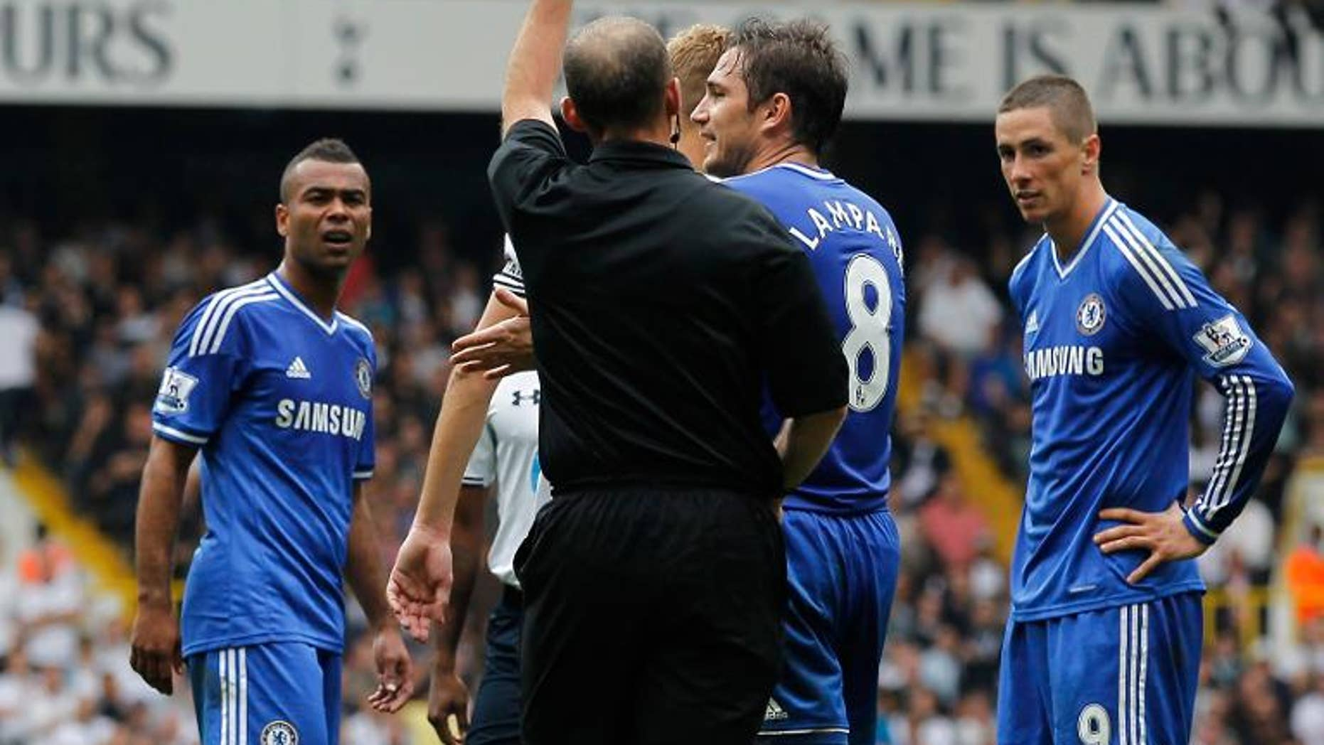 Chelsea's Spanish striker Fernando Torres (right) is shown the red card for a second bookable offence during a match with Tottenham Hotspur at White Hart Lane, September 28, 2013