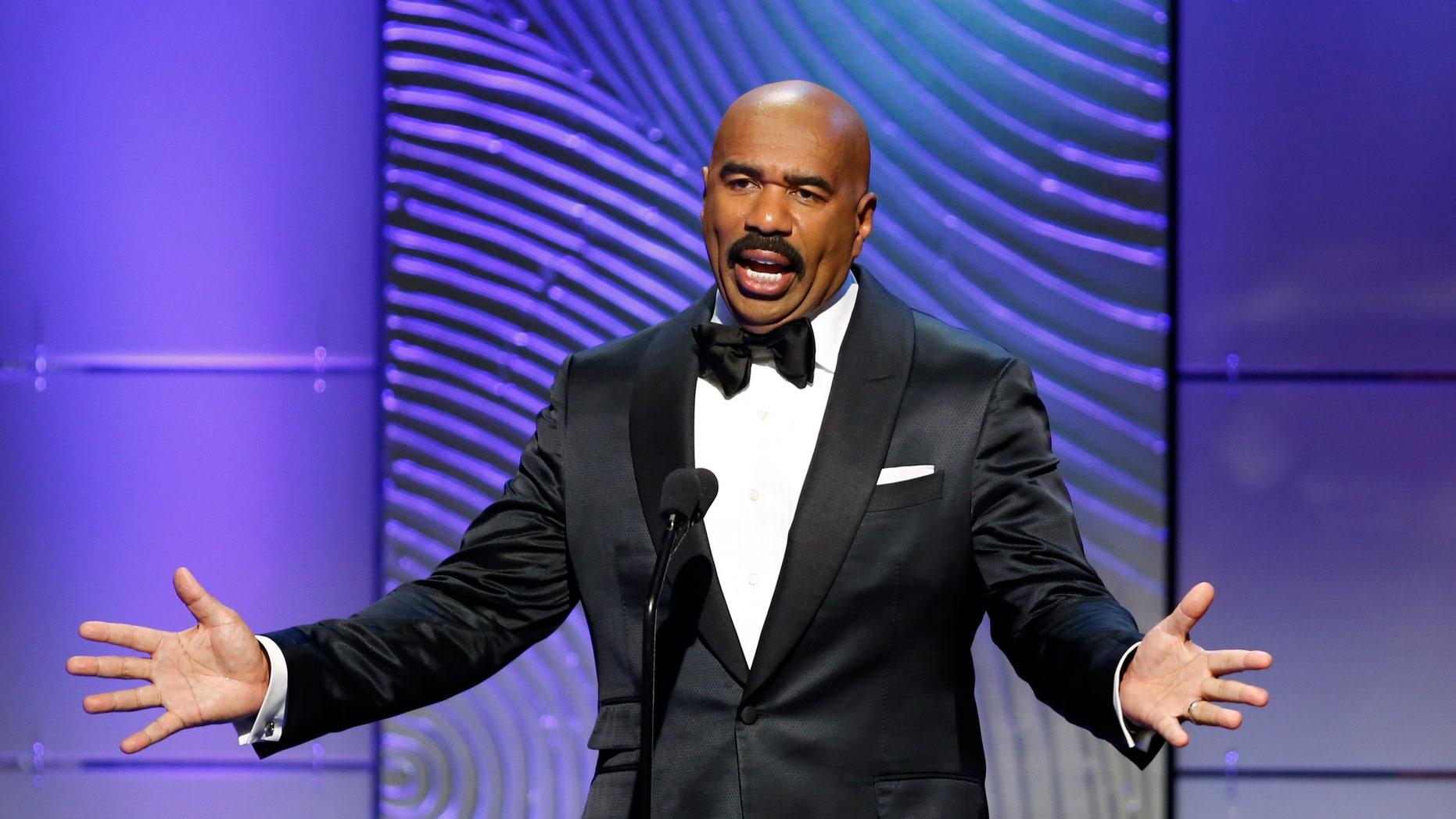 TV host Steve Harvey presents the outstanding morning program award during the 40th annual Daytime Emmy Awards in Beverly Hills, California June 16, 2013.