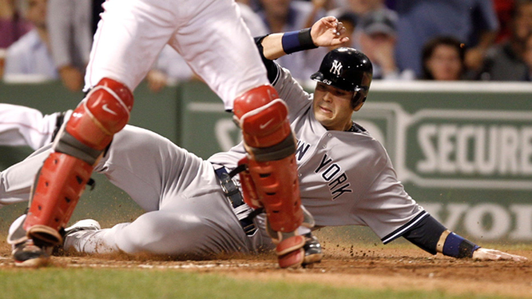 Sept. 1: New York Yankees' Jesus Montero slides home safely behind Boston Red Sox catcher Jarrod Saltalamacchia on a double by Russell Martin during the seventh inning of a baseball game at Fenway Park in Boston. (AP Photo/Winslow Townson)