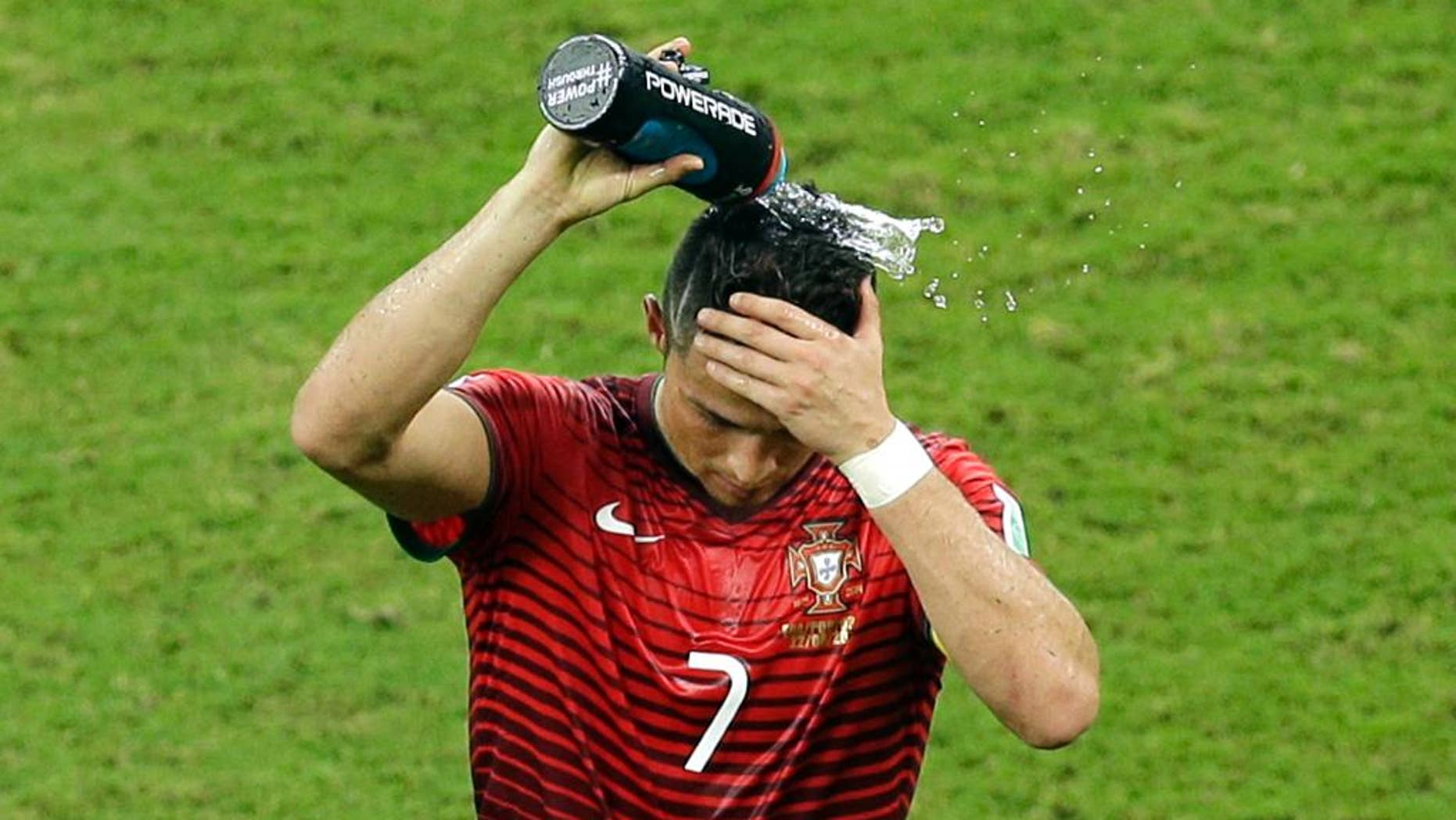 Portugal's Cristiano Ronaldo pours water over his head during the group G World Cup soccer match between the USA and Portugal at the Arena da Amazonia in Manaus, Brazil, Sunday, June 22, 2014. (AP Photo/Themba Hadebe)