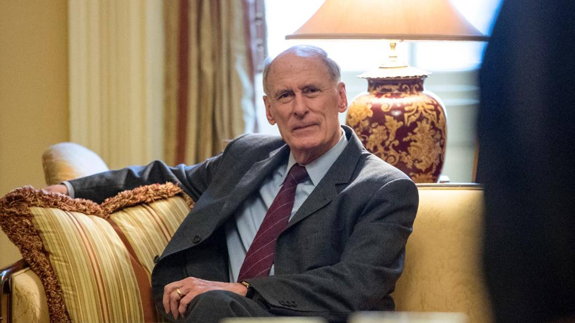 FILE - In this Jan. 23, 2017, file photo, National Intelligence Director nominee, former Indiana Sen, Dan Coats waits for the start of a meeting with Senate Majority Leader Mitch McConnell of Ky. on Capitol Hill in Washington. Partisan discord is seeping into House and Senate intelligence committee investigations of the Kremlin's interference in the 2016 presidential election and whether President Donald Trump has ties to Russia. The issue will likely surface at the Feb. 28 Senate confirmation hearing for former Coats. (AP Photo/J. Scott Applewhite, File)