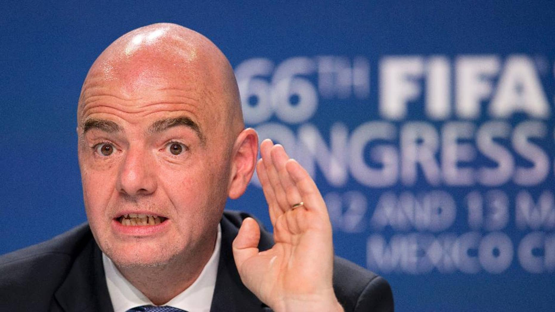 FIFA President Gianni Infantino gives a press conference following the closing of the 66th FIFA Congress in Mexico City, Friday, May 13, 2016. FIFA's corruption crisis was declared to be over by Infantino on Friday as the scandal-battered governing body broke new ground by appointing a Senegalese United Nations official as its first female and first non-European secretary general. (AP Photo/Rebecca Blackwell)