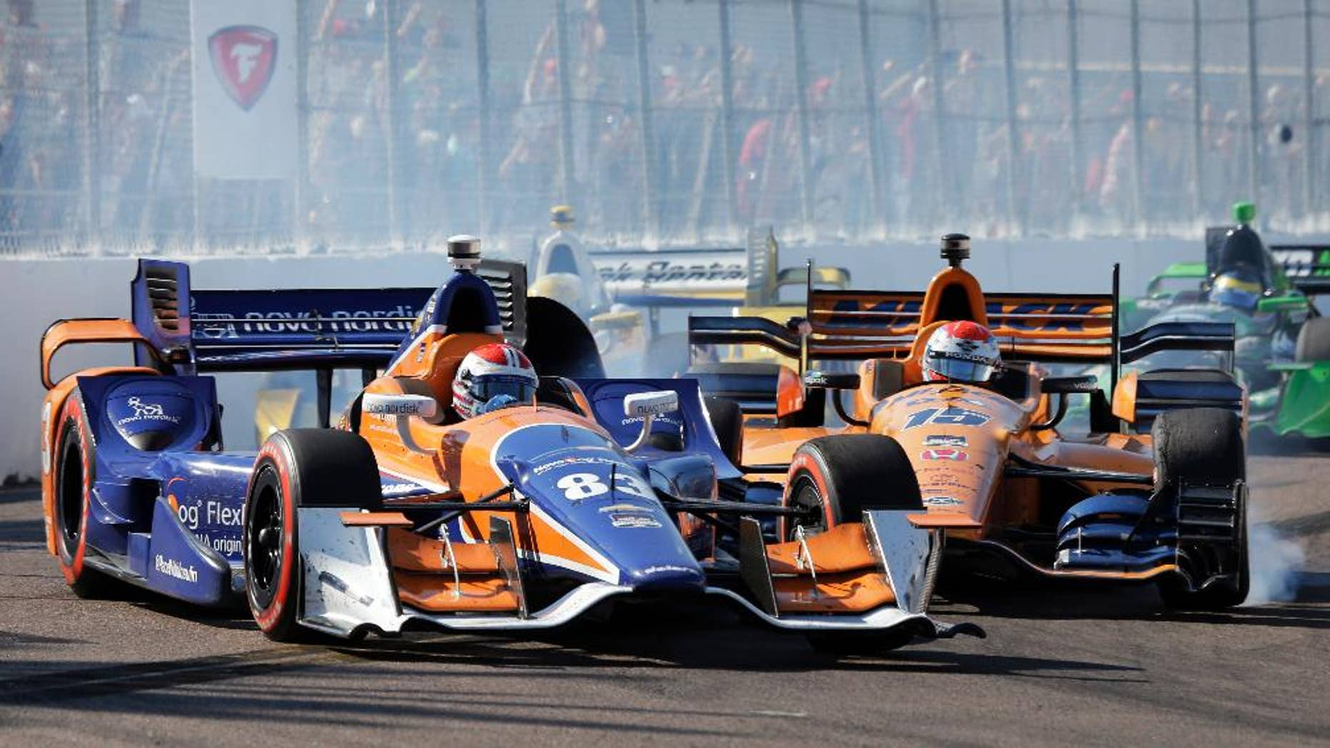 Charlie Kimball (83) gets hit by Graham Rahal while driving into Turn 10 during the IndyCar Firestone Grand Prix of St. Petersburg auto race Sunday, March 29, 2015, in St. Petersburg, Fla.  (AP Photo/Chris O'Meara)