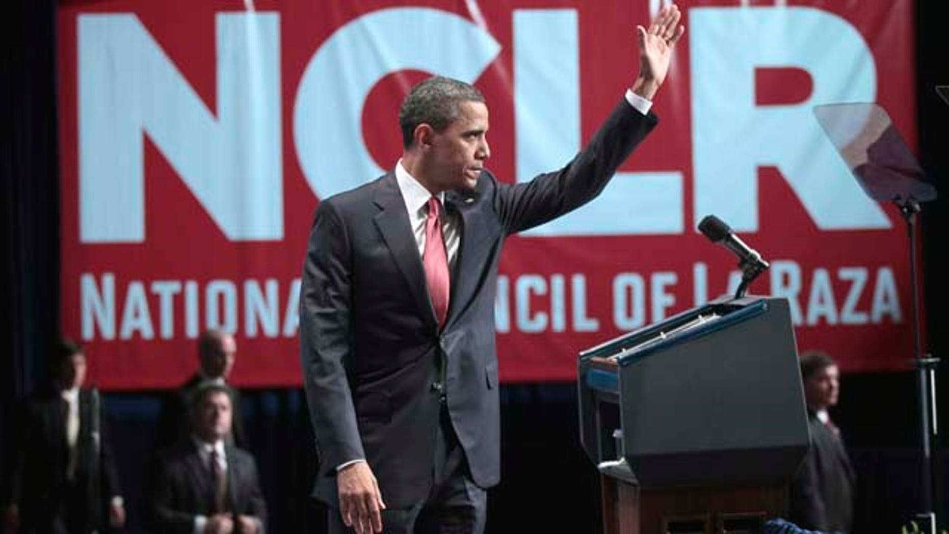 President Barack Obama waves as he prepares to walks off stage after delivering remarks at the National Council of La Raza (NCLR) annual conference luncheon in Washington, Monday, July 25, 2011. (AP Photo/Pablo Martinez Monsivais)